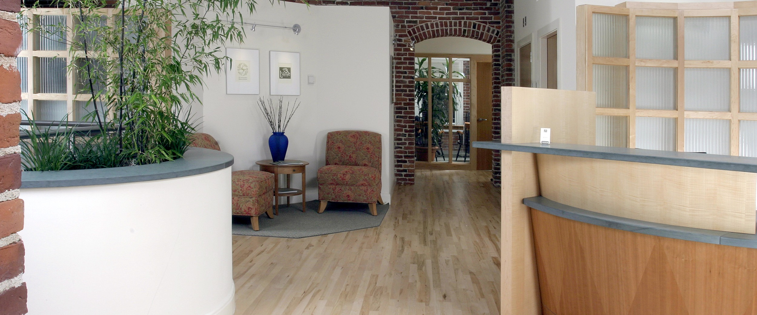 """Interior brick walls were exposed and the original windows were renovated and reworked.  The first floor is comprised of two retail tenants, and the upper two floors provide first class office space with a historic """"loft style"""" character."""