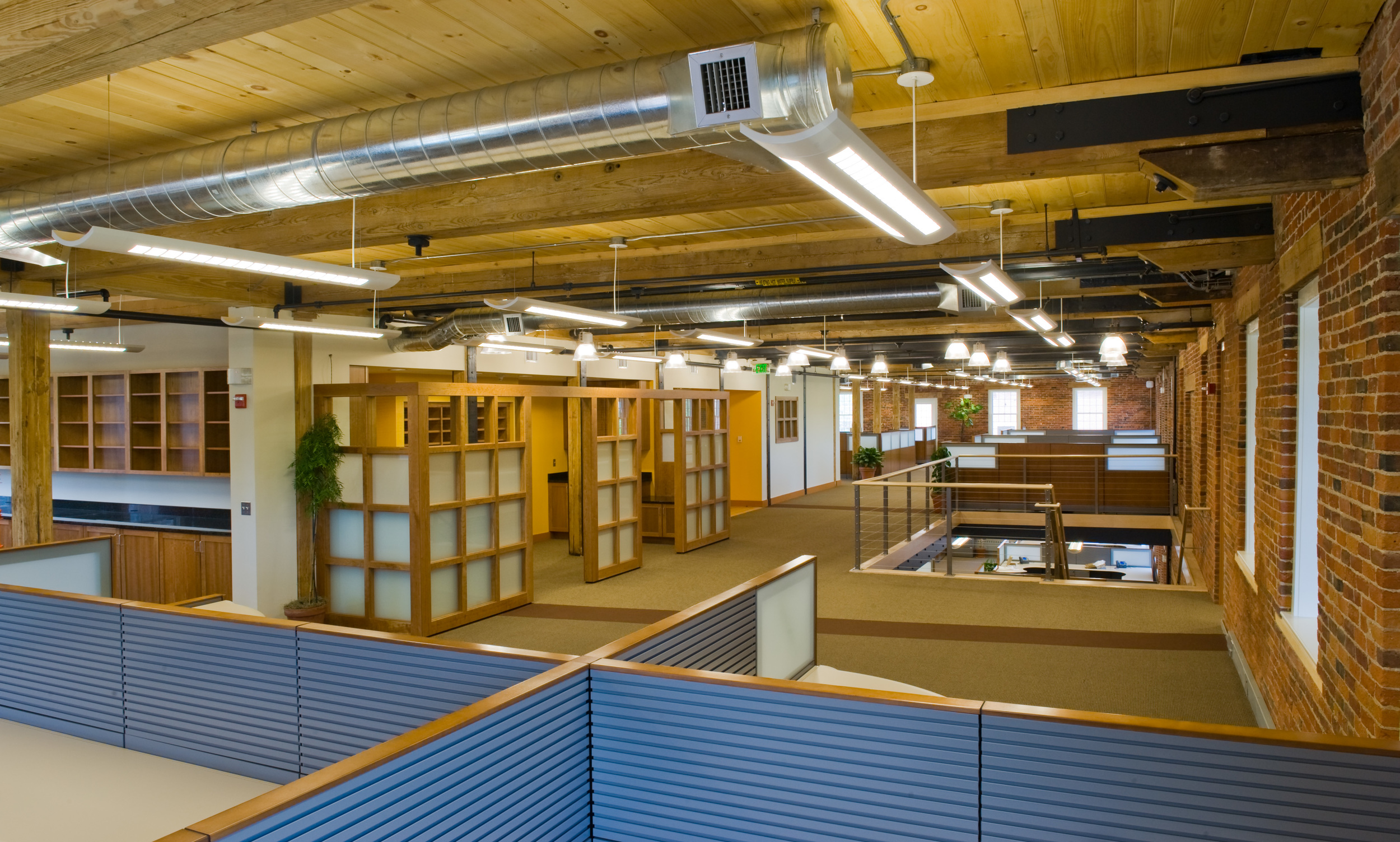 This project is 19,000 gross sf, on 2 floors including an executive suite, 2 conference rooms, company kitchen and lunchroom, server and technical services space, along with space for 70 staff members. The majority of the space is open and features an internal stair in a newly created floor opening, enhancing the feeling of collaboration.