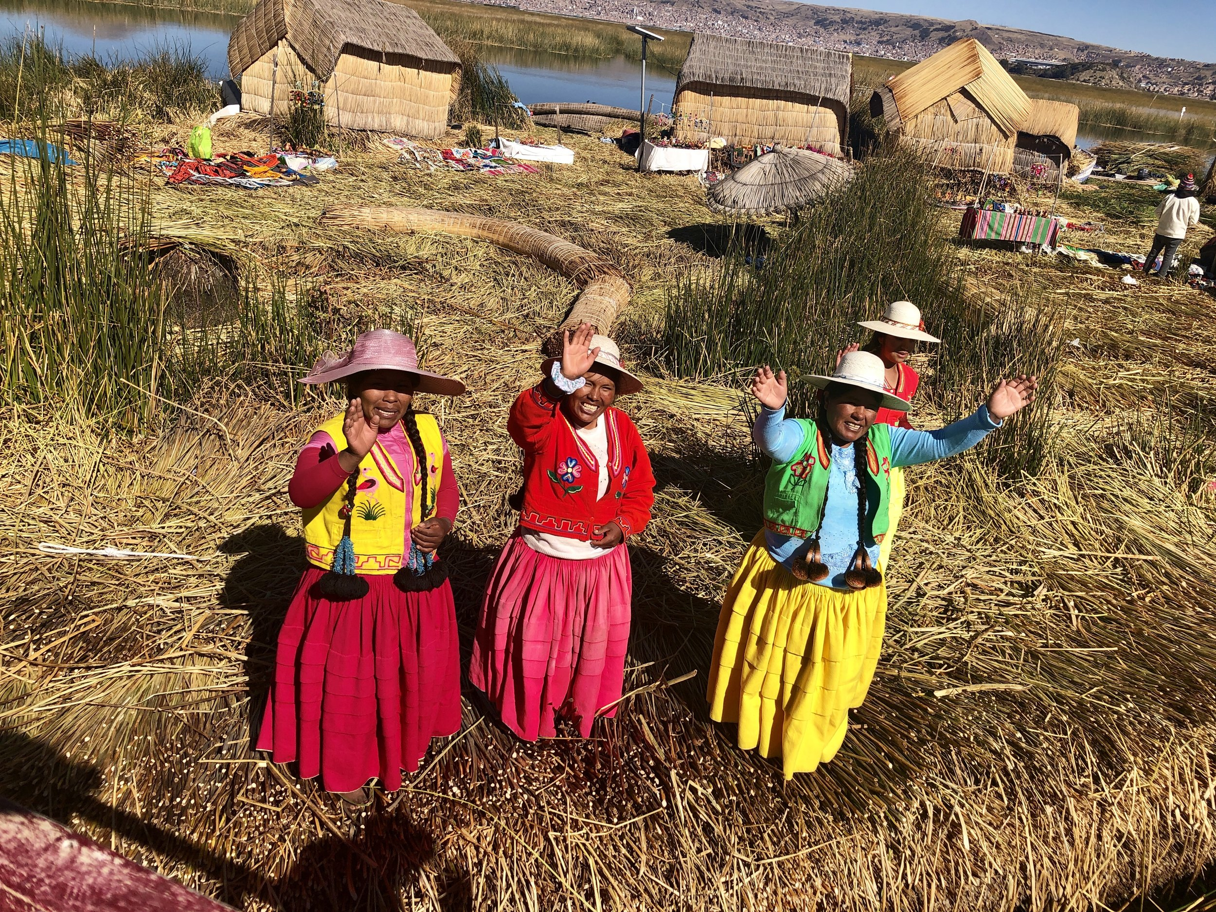Peruvian people waving hello.JPG