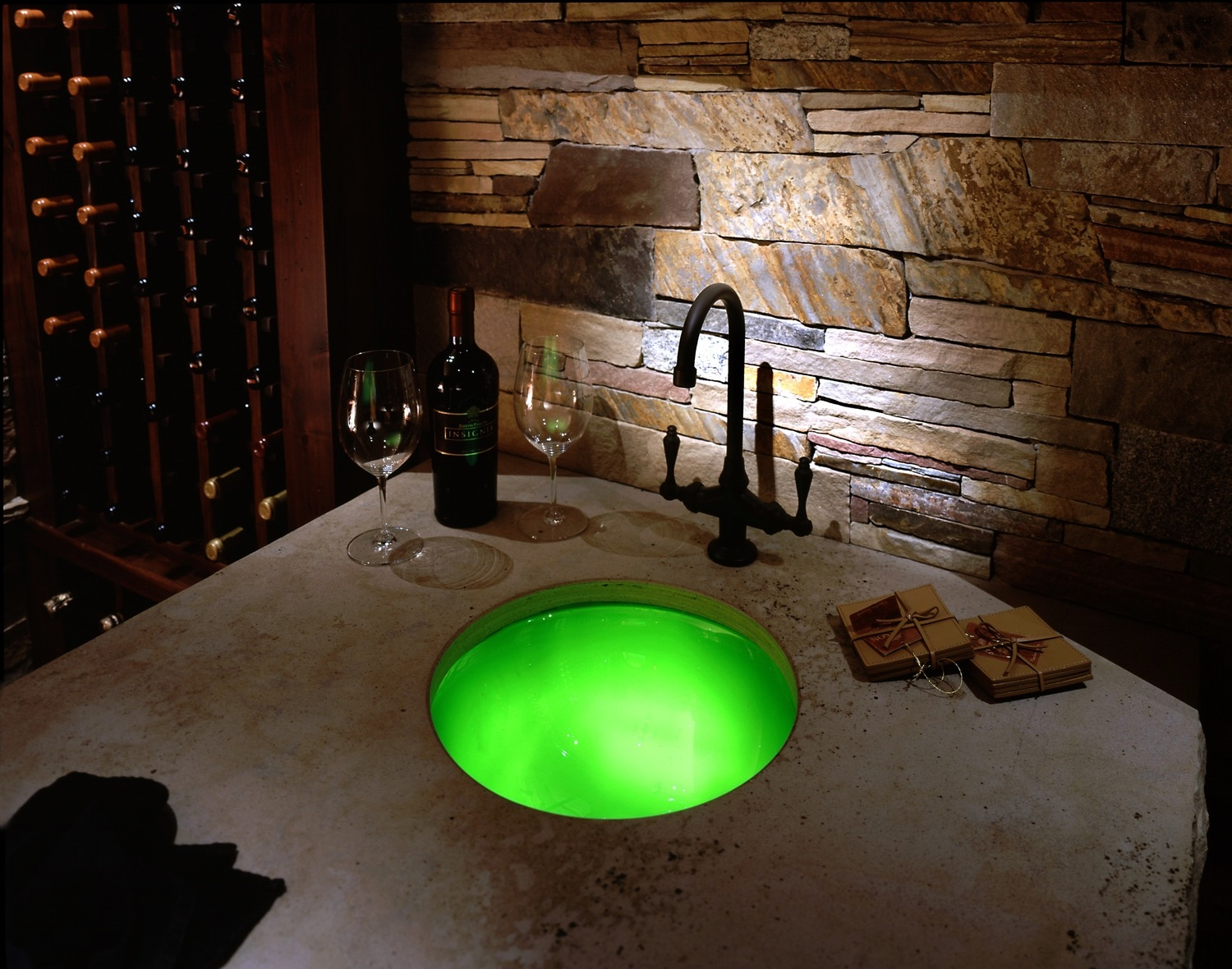 Fiber Optic illuminated stone wall with Dim-able back lit LED frosted glass sink, adjustable to up to 16 million colors.