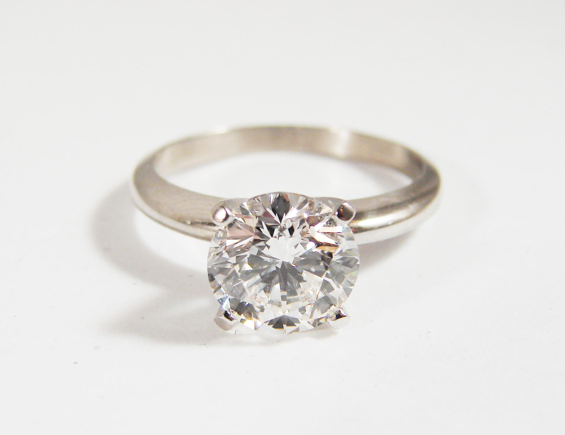 1.5ct center diamond set in18kt white gold solitaire ring.  Starting at $12,000 for stone size  Can be customizable with any stone, size, metal etc. starting as low as $700