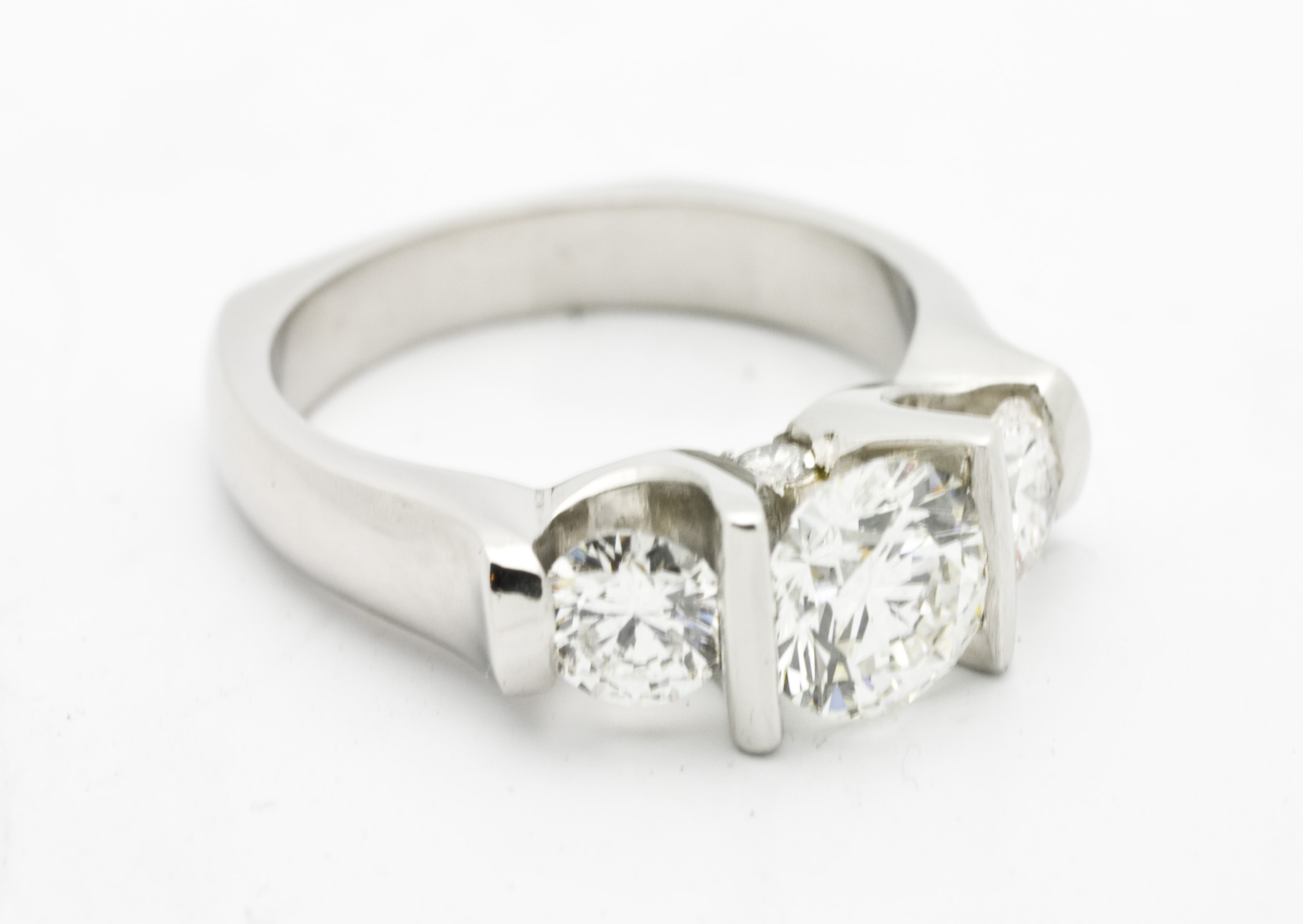 Three stone diamond ring set in 18kt white gold 0.90ct diamond center stone, 0.35tcw diamond side stones.  Starting at $7800 for this stone size  Can be customizable with any stone, size, metal etc.
