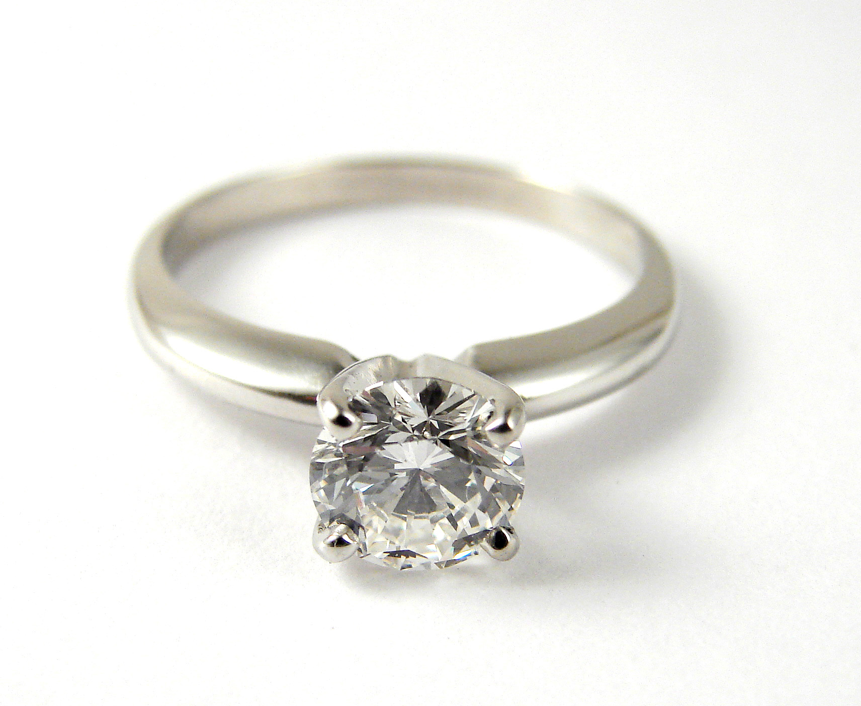 18kt white gold 0.80ct diamond solitaire ring with classic curved timeless band.  Starting at $4000 in this stone size and quality  Can be customizable with any stone, size, metal etc.