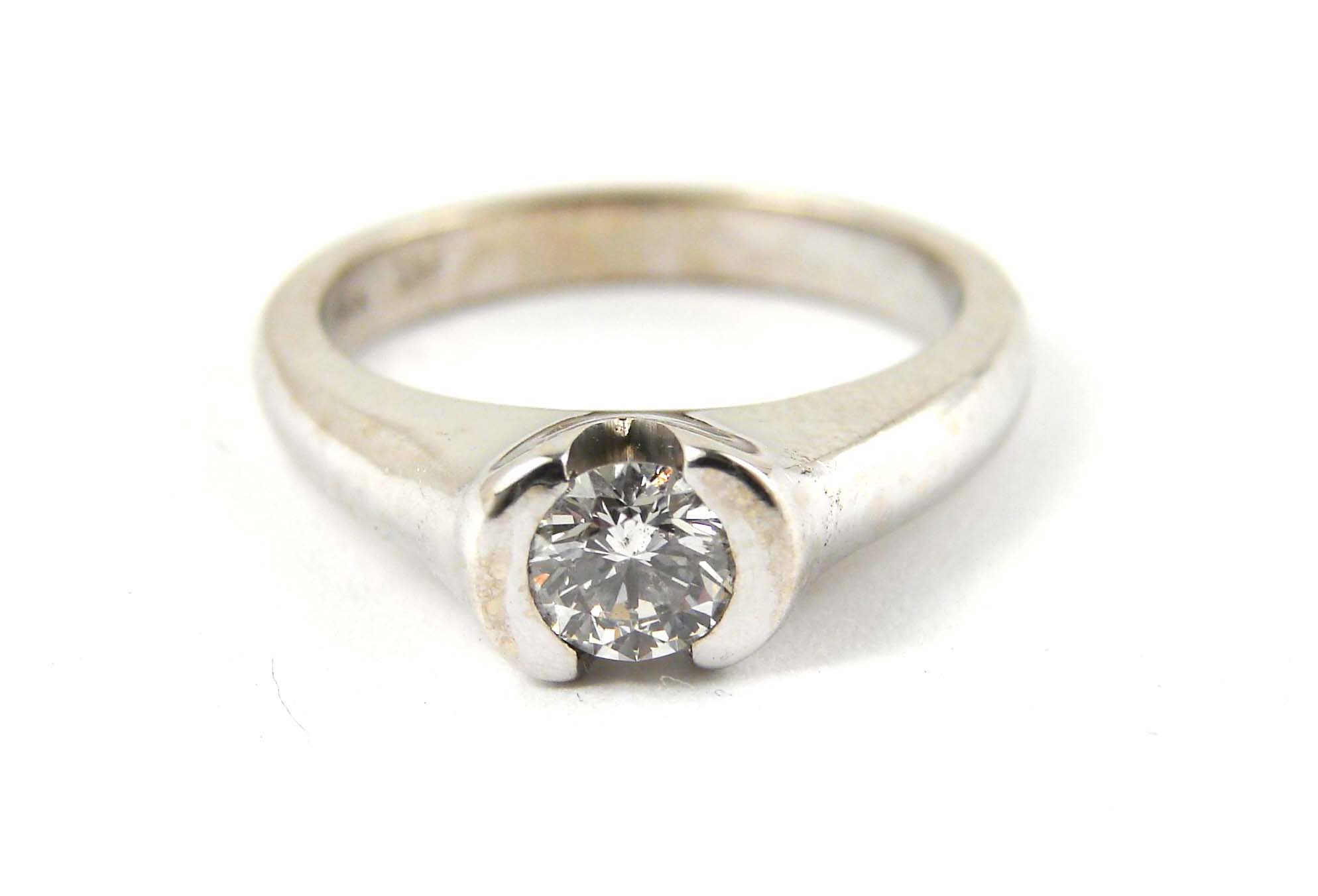0.57ct diamond center stone set in a 14kt white gold wide semi bezel, very classic and practical setting.  Starting at $2800 for this stone size and SI clarity and GH colour  Can be customizable with any stone, size, metal etc.