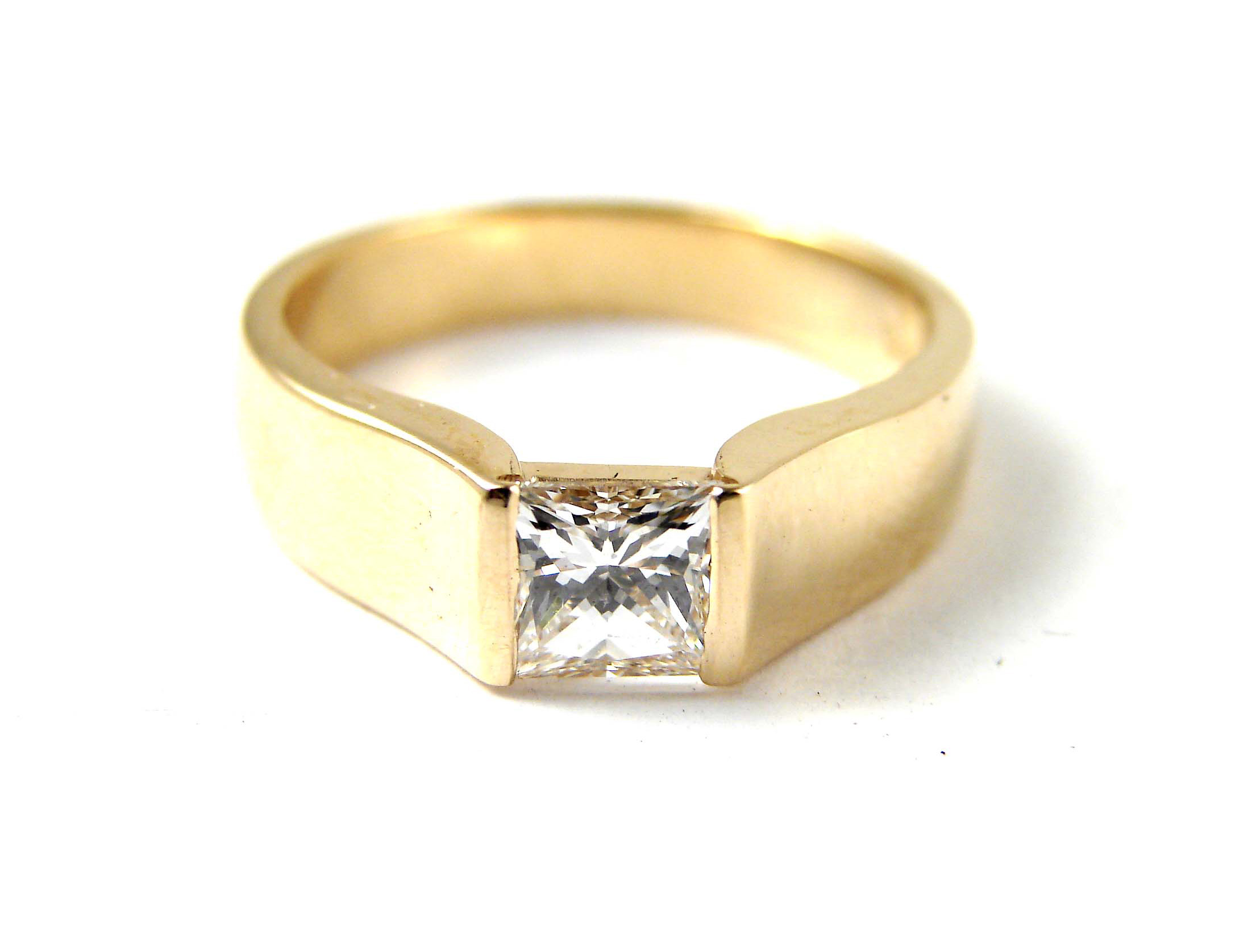 0.70ct princess cut diamond in a 18kt yellow gold tension set look ring.  Starting at $3900 for this stone size and quality  Can be customizable with any stone, size, metal etc.