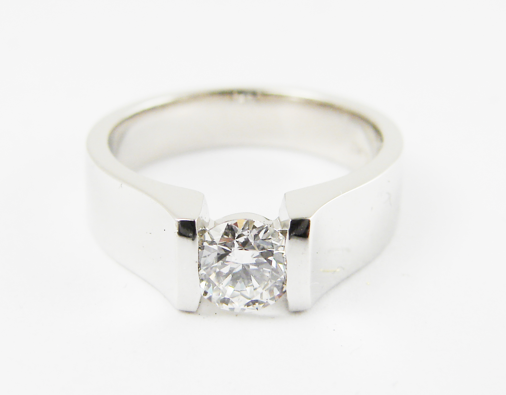 0.55ct round brilliant cut diamond tension set in a heavy platinum setting.  Starting at $6000 for this stone size andVVS-2 clarity F colour  Can be customizable with any stone, size, metal etc.