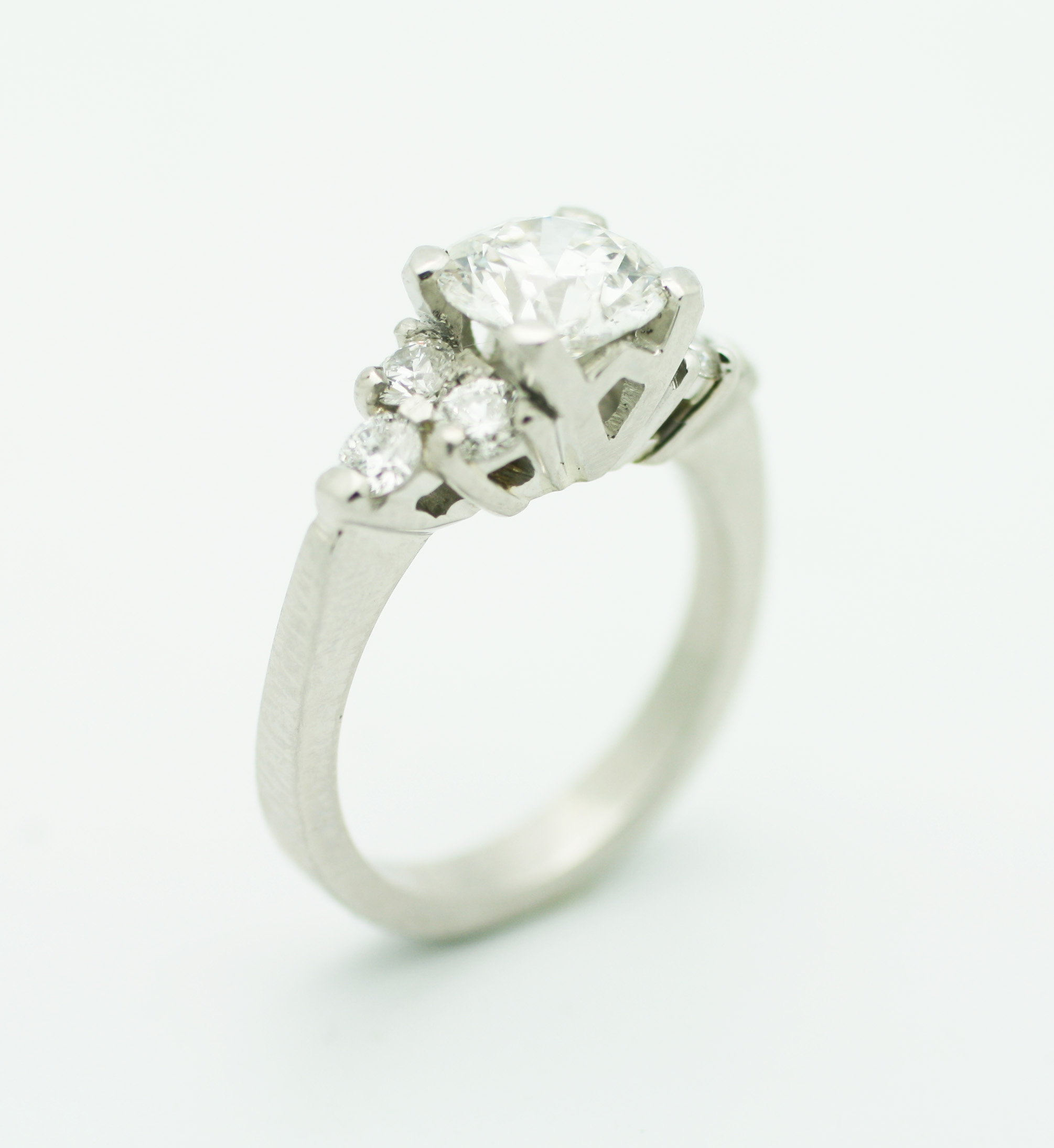 1.8ct round brilliant cut diamond, 0.43tcw diamond side stones, platinum setting  Starting at $19,000 for this stone sizeSI-2 clarity and G colour  Can be customizable with any stone, size, metal etc.
