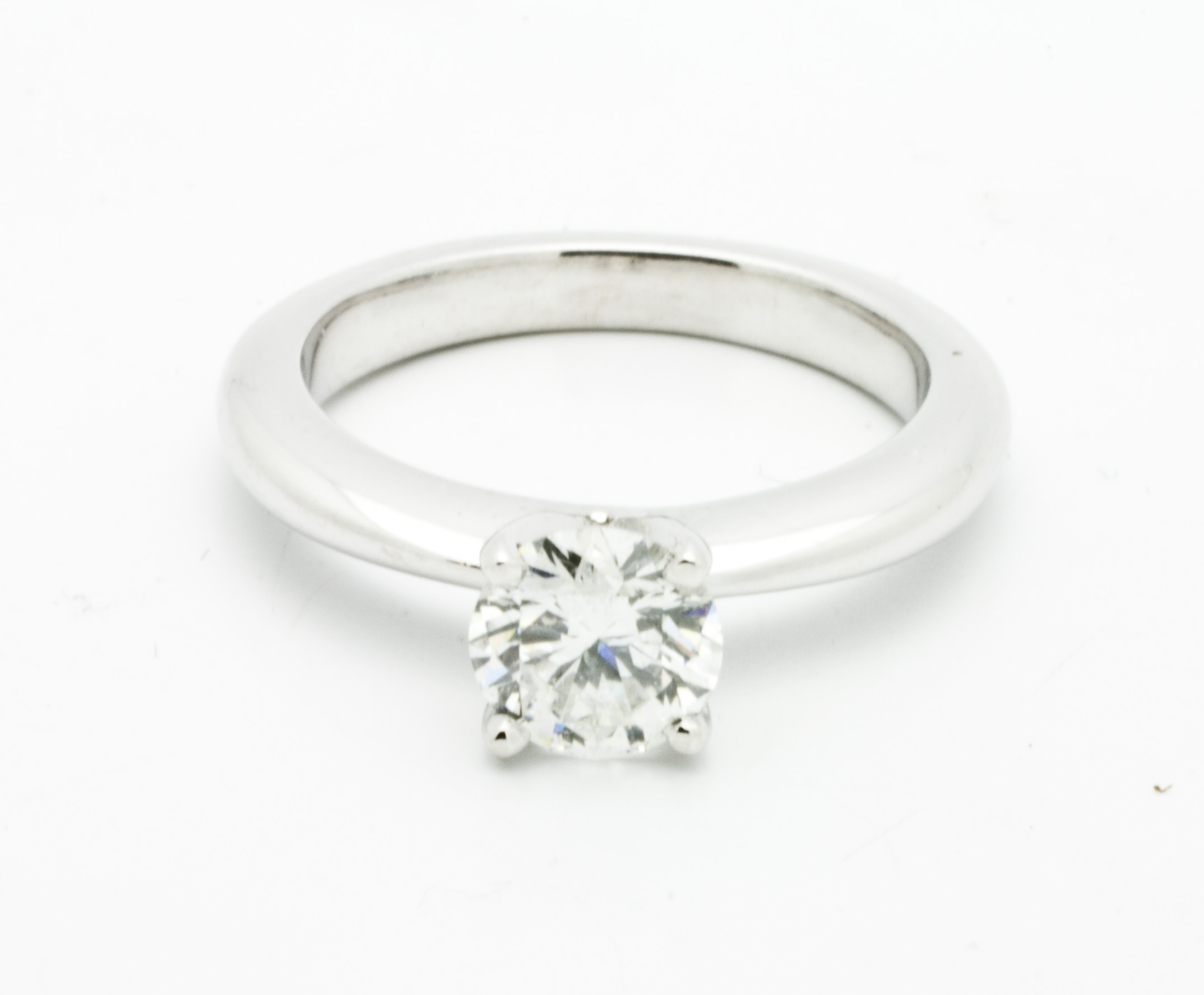 0.42ct round brilliant cut diamond center stone,14kt white gold, traditional 4 claw solitaire ring.  Starting at $2000 for this stone size andSI-1 clarity F colour  Can be customizable with any stone, size, metal etc.