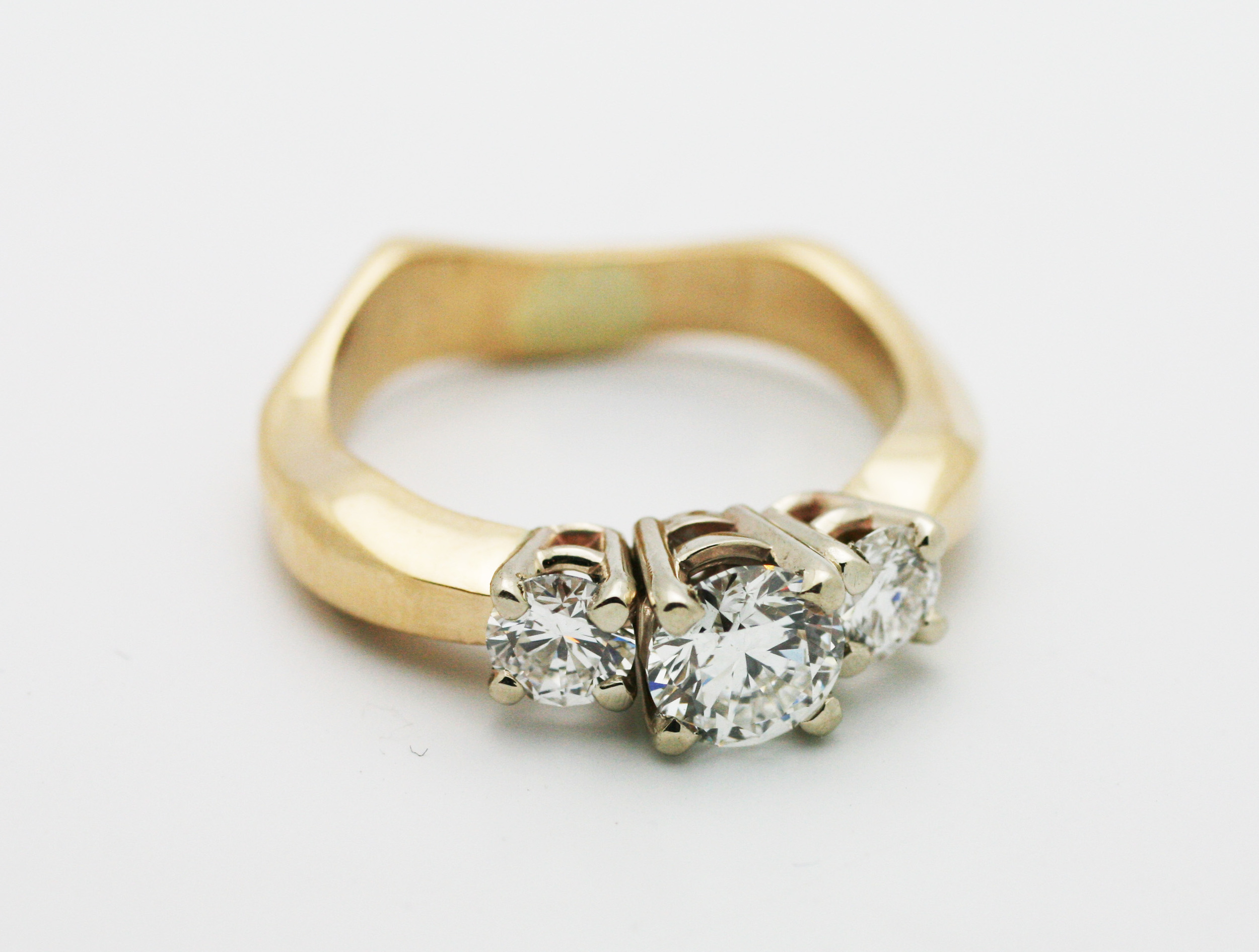 0.80tcw diamond center stone, 0.40tcw diamond side stones, 14kt yellow gold.  Starting at $5800 for this stone size andSI clarity for all stones  Can be customizable with any stone, size, metal etc.