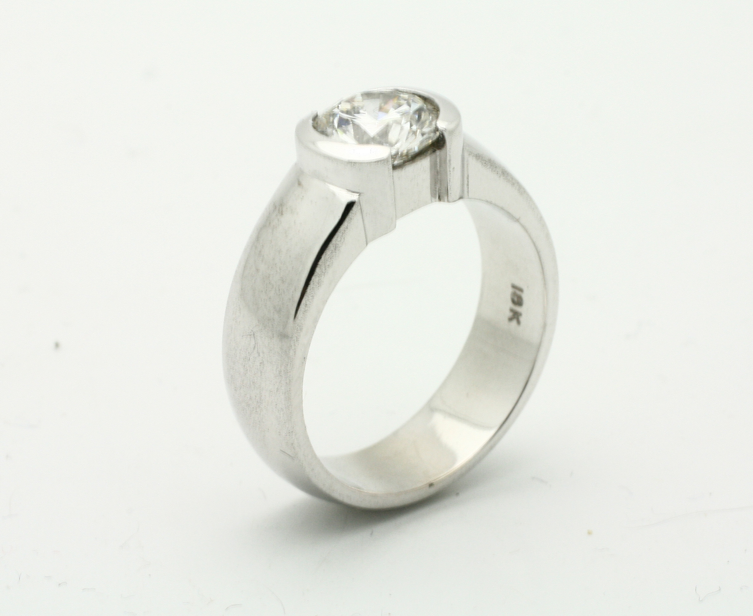 0.85ct round brilliant cut diamond center stone set in a 14kt white gold mount.  Starting at $5600 for this stone size andSI-1 clarity H colour  Can be customizable with any stone, size, metal etc.