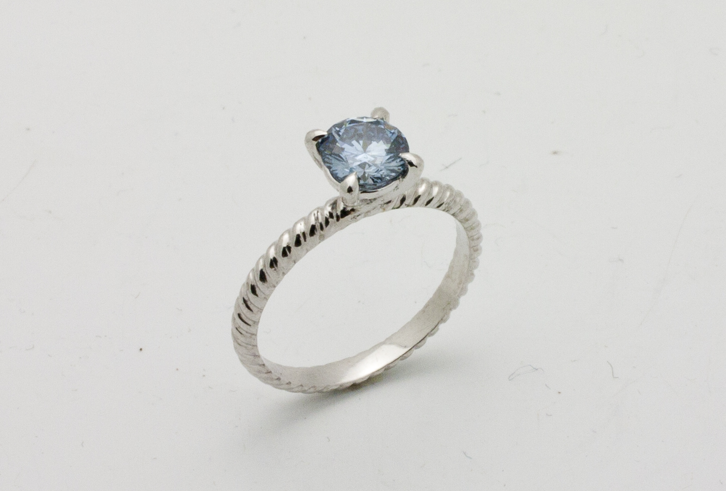 Created 0.83ct blue diamond stone with a twisted platinum band.  Starting at $$7500.00 in this size and quality  Can be customizable with any stone, size, metal etc.