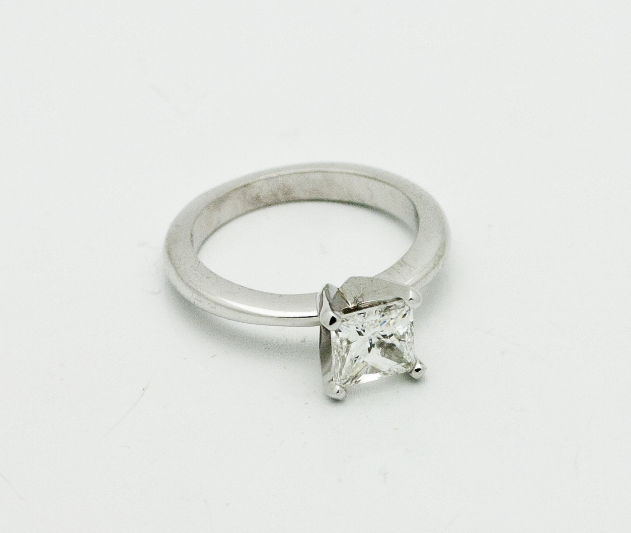 0.85ct princess cut diamond center stone in, 18kt white gold diamond solitaire ring.  Starting at $4500 for this stone size and quality  Can be customizable with any stone, size, metal etc.