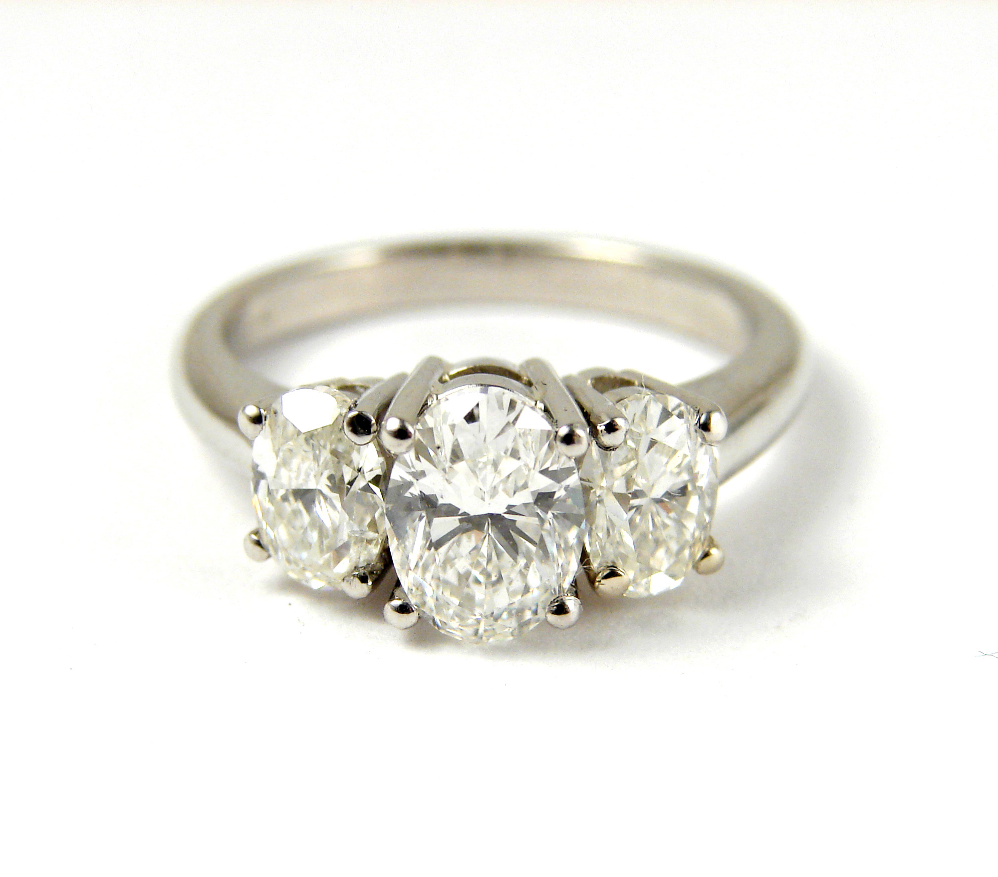 3 stone oval ring, 1.00ct diamond center stone, 1.00tcw diamond side stones, platinum mount.  Starting at $10,800 for this stone size and quality  Can be customizable with any stone, size, metal etc.