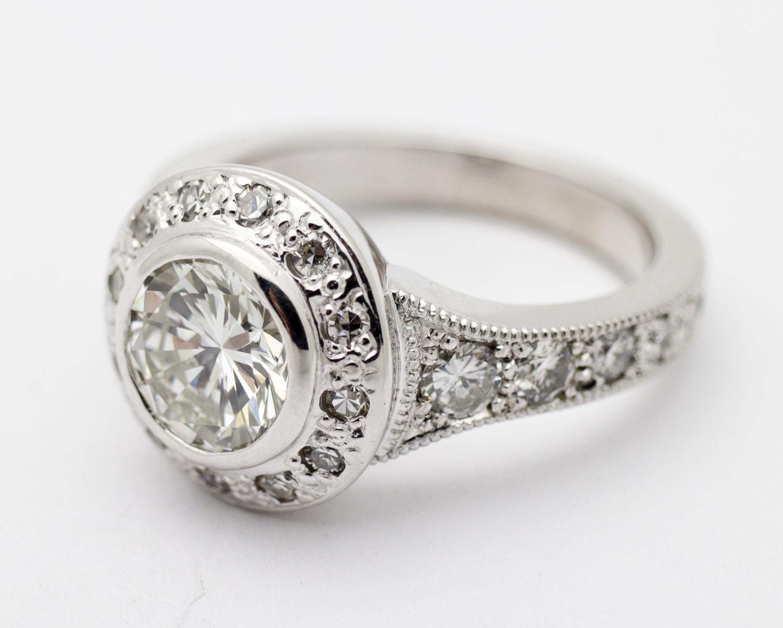diamonds around white gold band, single princess cut diamond.jpg