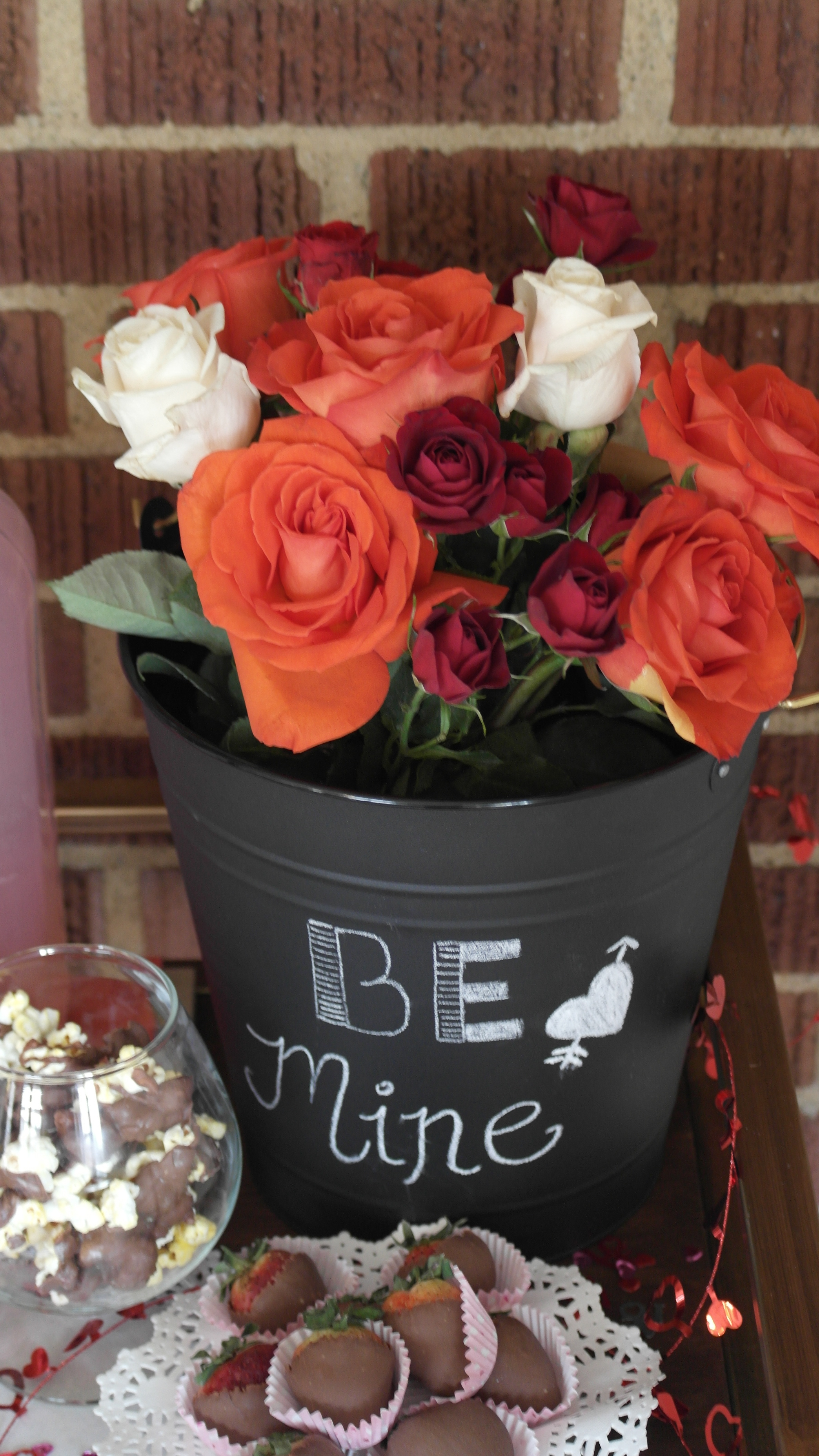 Red and White Roses in Black Bucket