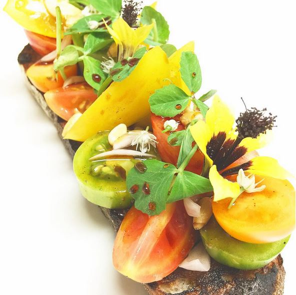Tomatoes on Toast at Community Table | Photo via    @simonmarcell