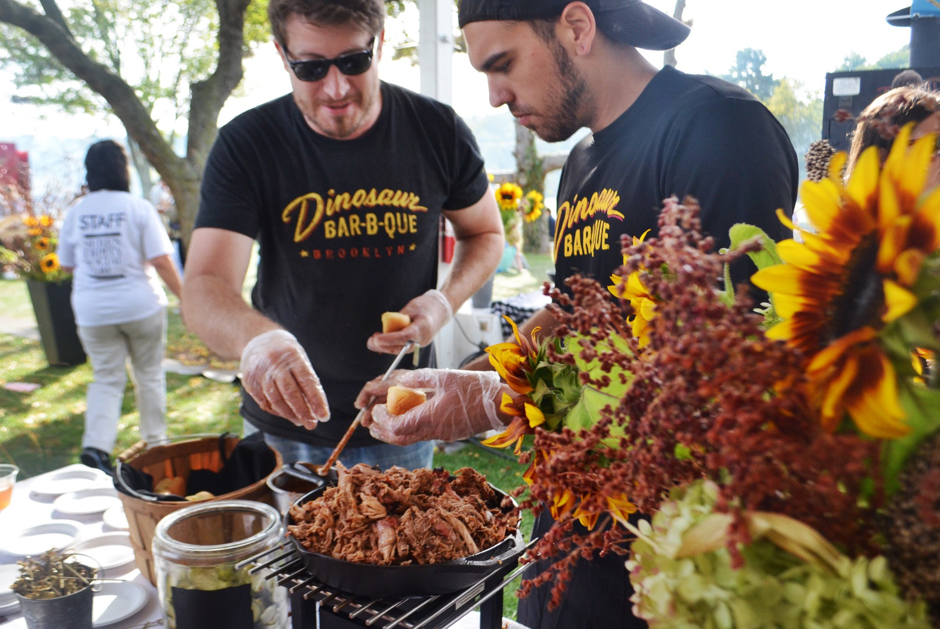 The fellas from  Dinosaur BBQ  serving up their pulled pork sliders at the Grill Master party