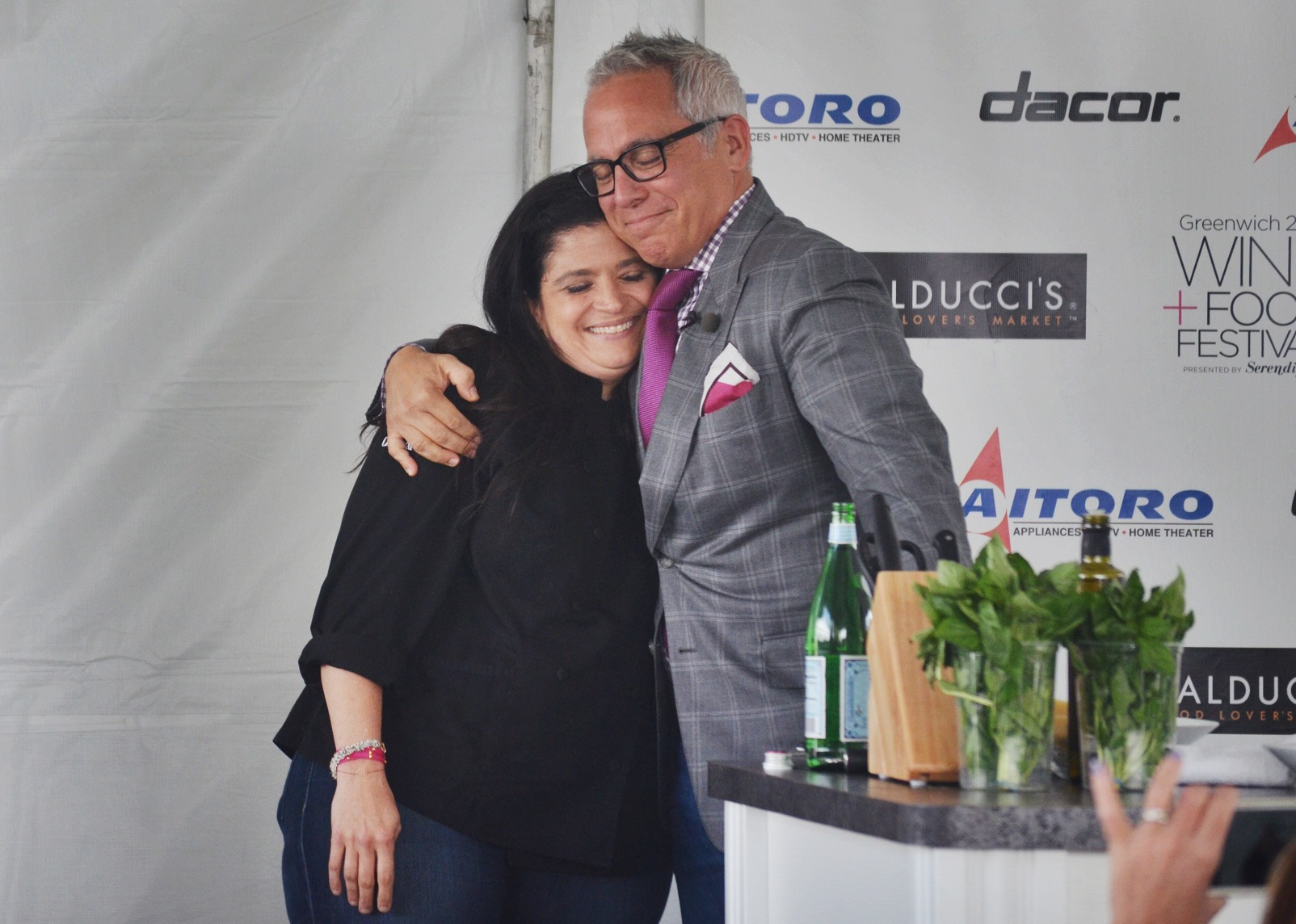 Precious moment between  Chef Alex Guarnaschelli  and  Chef Geoffrey Zakarian  before his cooking demonstration.