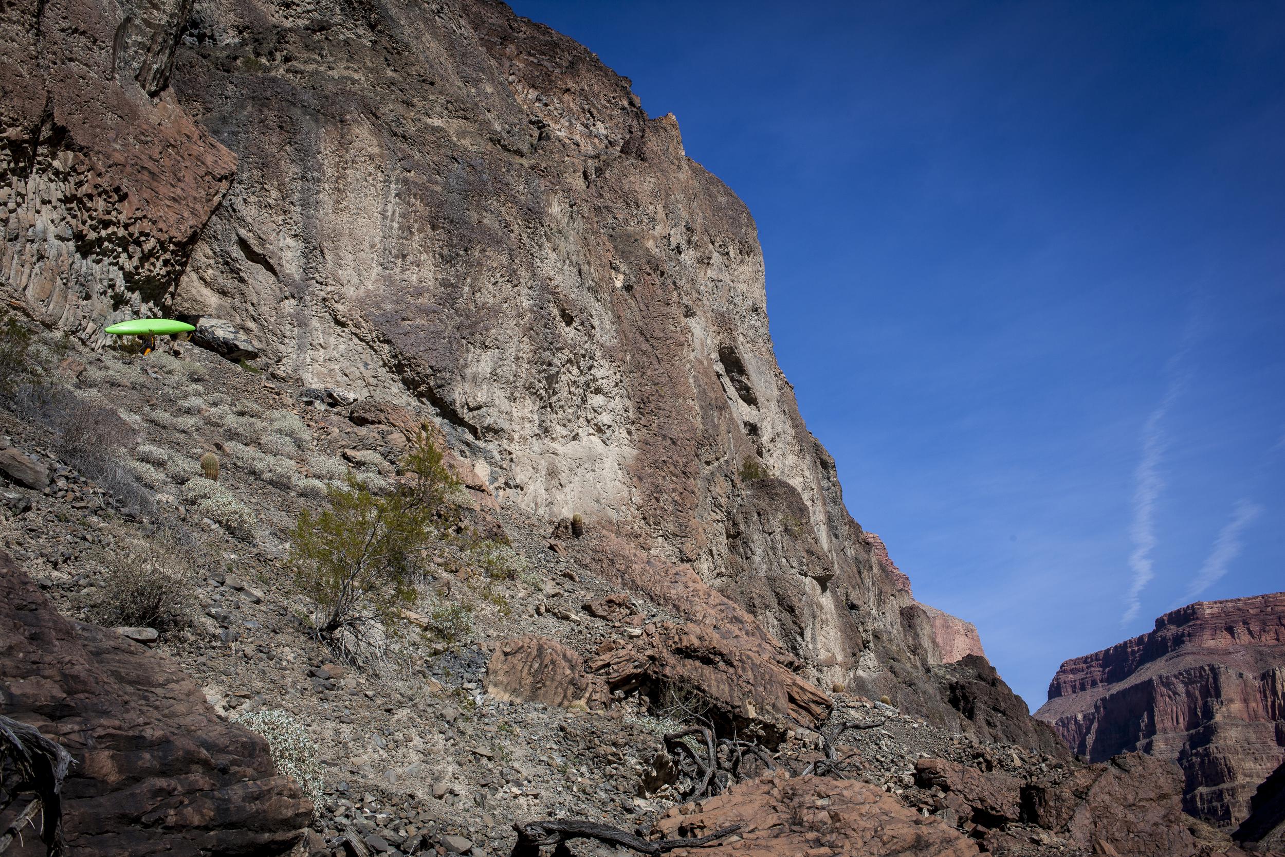 John Nestler carrying back upLava Falls. Grand Canyon, AZ. Credit: Robb Goodell