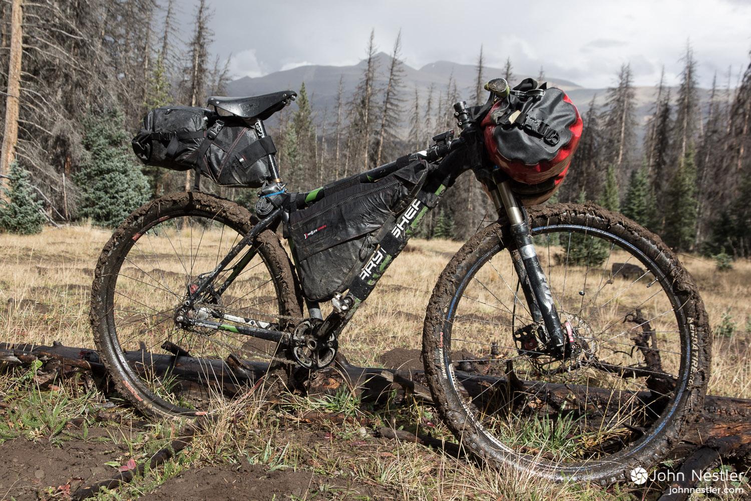 Brief bursts of rain turned the exposed earth into tacky mud that clung to the tires and prevented any type of riding. Shot shortly after  Spring Creek Pass  in Segment 22.