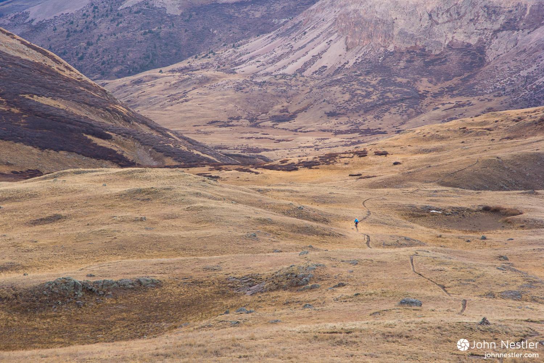 Gabriel, a fellow bikepacker, threads through the landscape on the Colorado Trail by Cataract Lake in Segment 23.