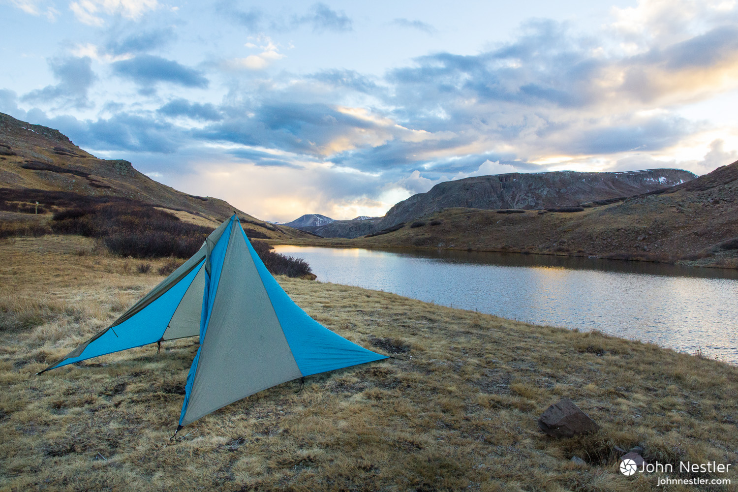 A view of possibly the most beautiful campsite on the whole trip. Few things match the experience of sunset colors and alpine lakes after a long day of riding. Shot by a small lake near Cataract Lake in Segment 23.