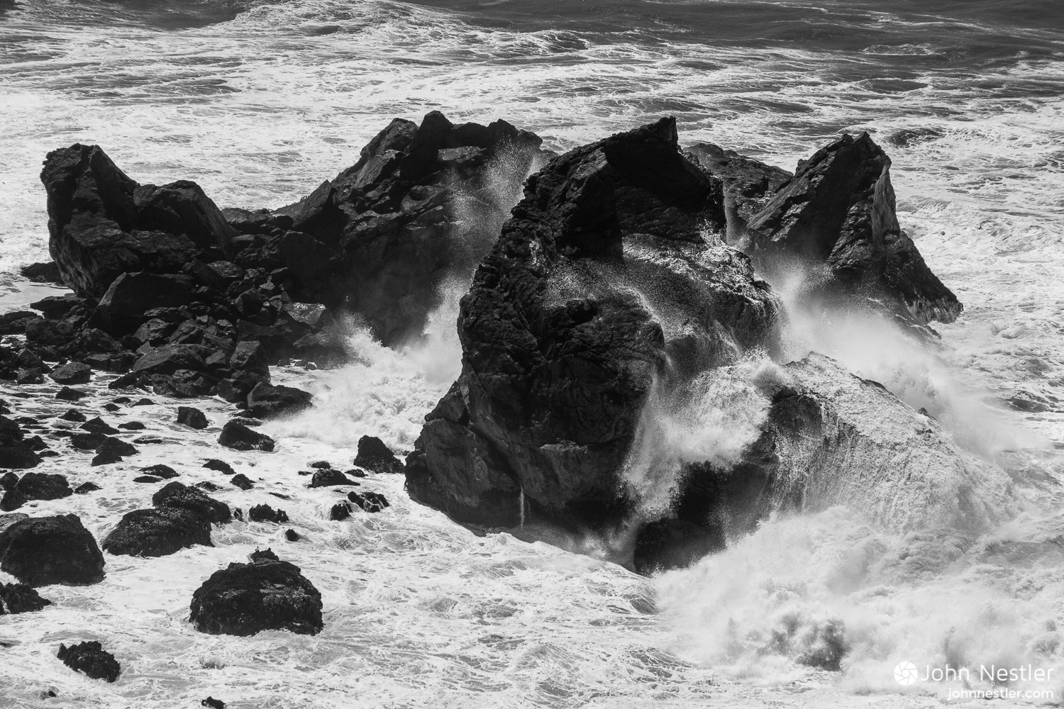 Mesmerizing surf battering a rock by  Patrick's Point State Park .