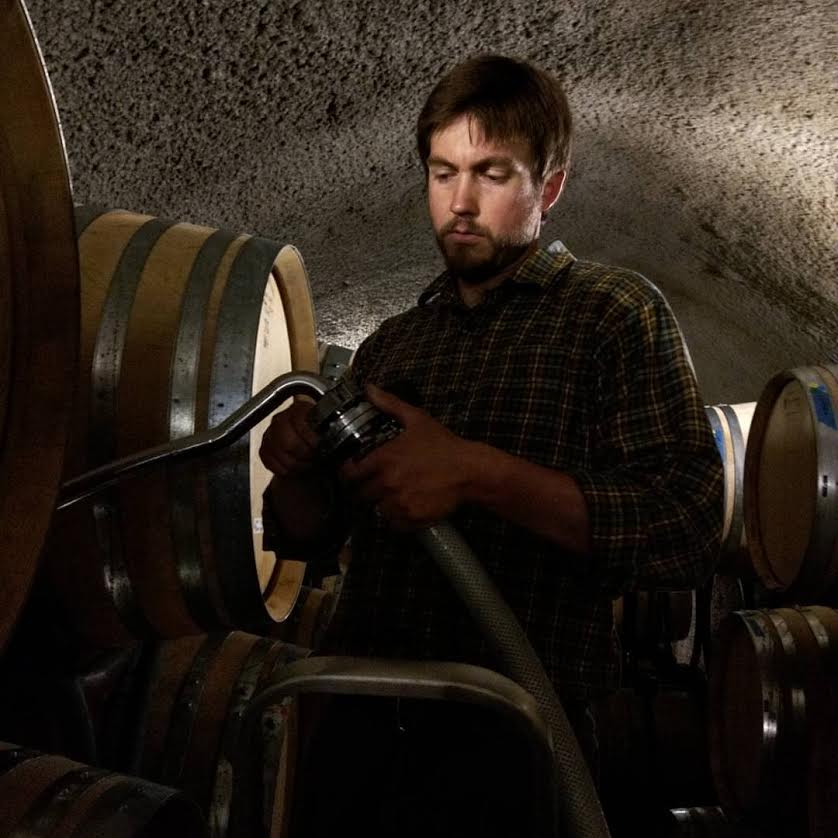 Winemaker, Ryan Kunde,    pumping wine into a barrel. This batch of pinot noir was processed and fermented on the skins. First, we put the free run (aka   the juice that was extracted on its own) into barrel. Then, the grapes will be pressed and its juice put into a separate barrel.