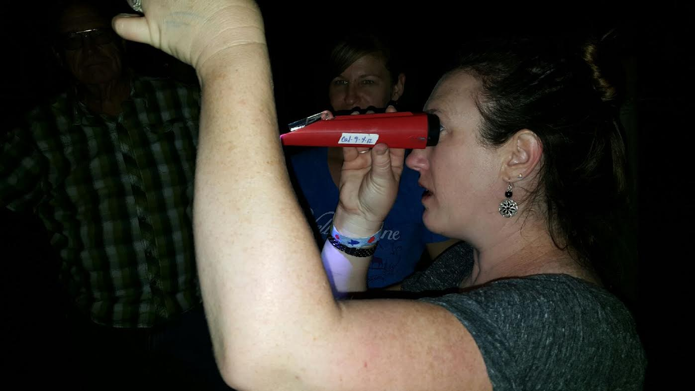Erin using refractometer to check brix.jpg