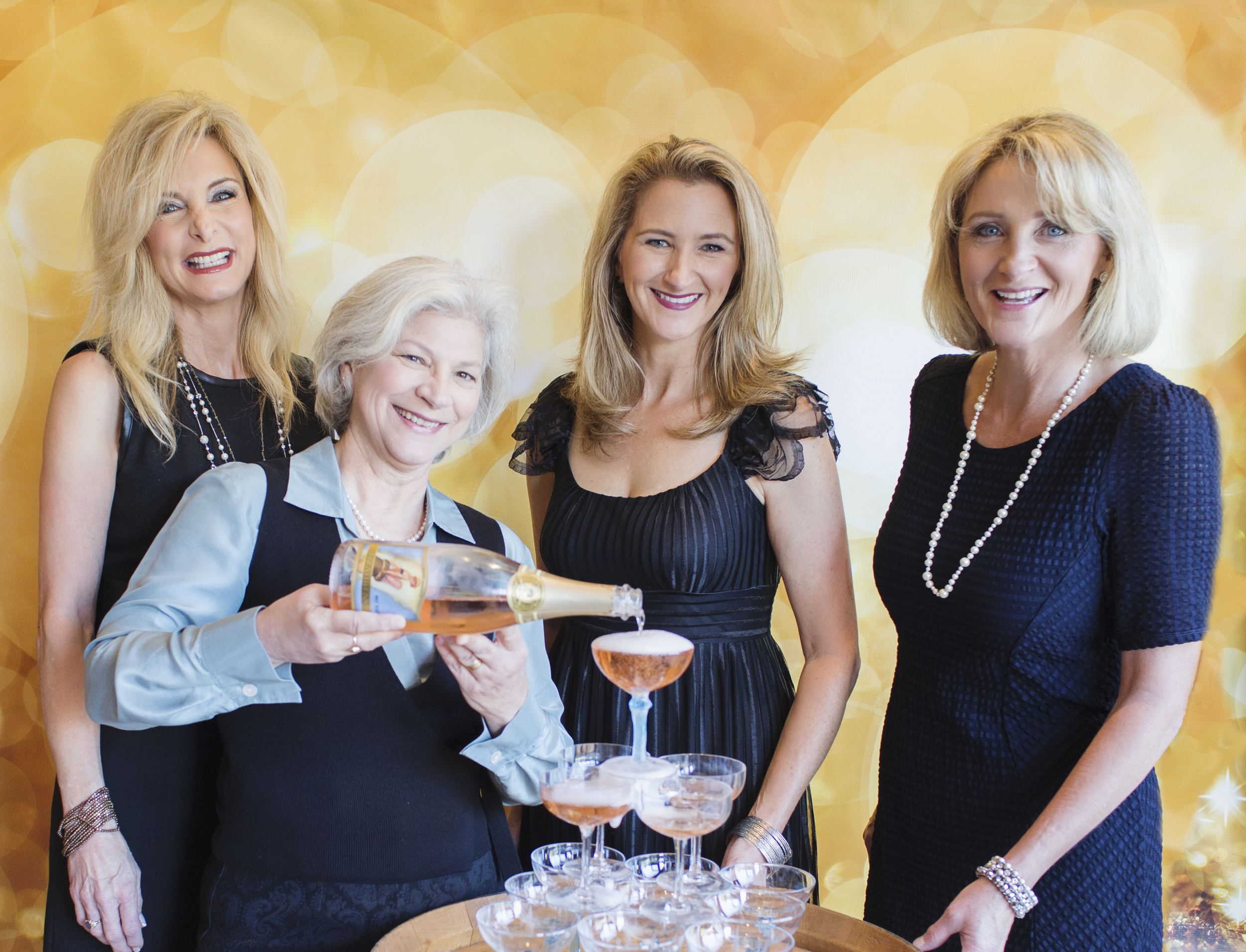 The Breathless Wine Team: (L->R): Sharon Cohn, winemaker Penny Gadd-Coster (pouring), Cynthia Faust, and Rebecca Faust