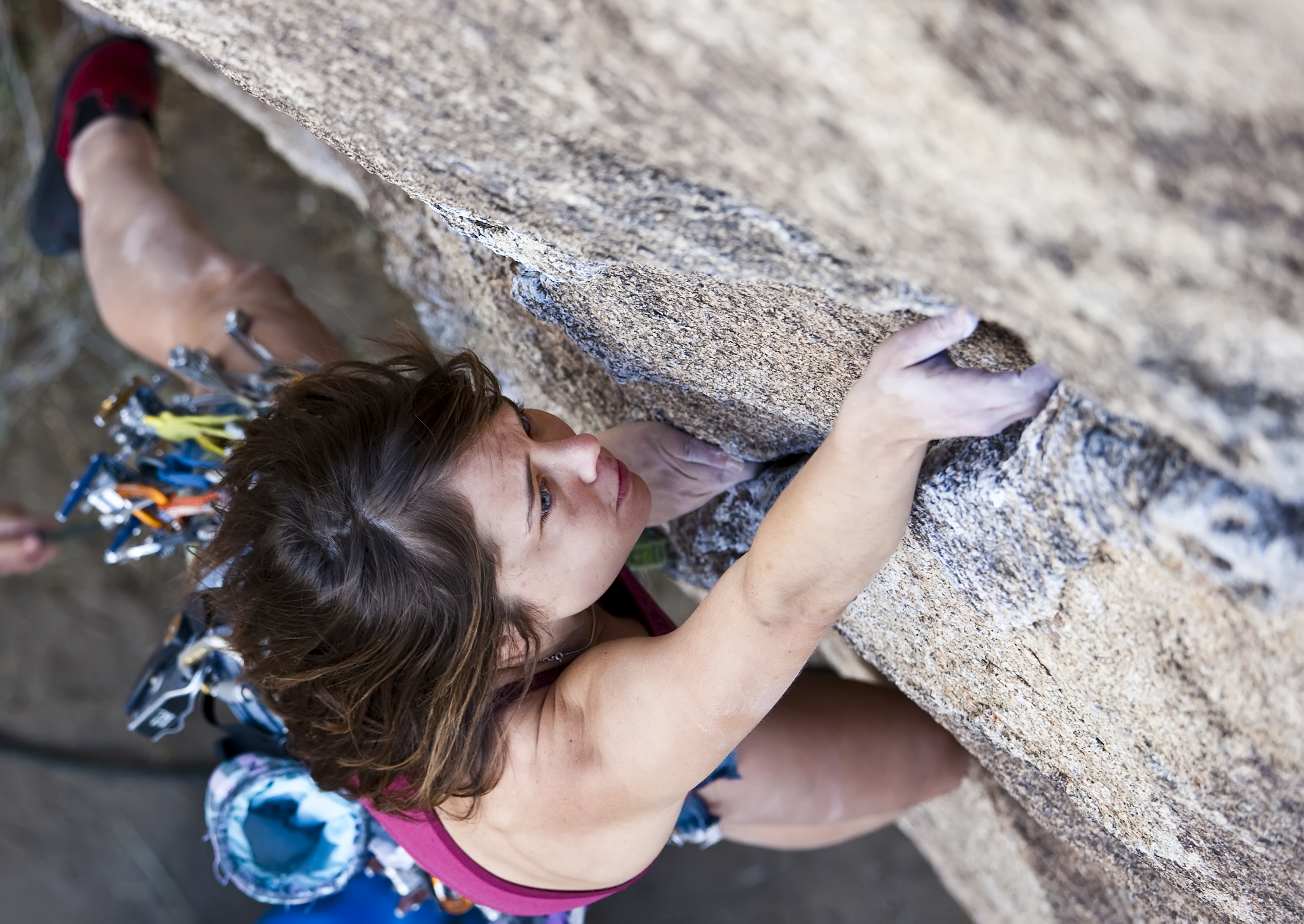 Young Woman Focused on the Climb