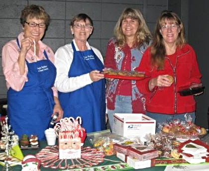 Nina Grayson, from left, Ginny Hale, Barb Dixon and Gail Besser provide refreshments at a previous Santa's Gift House event.
