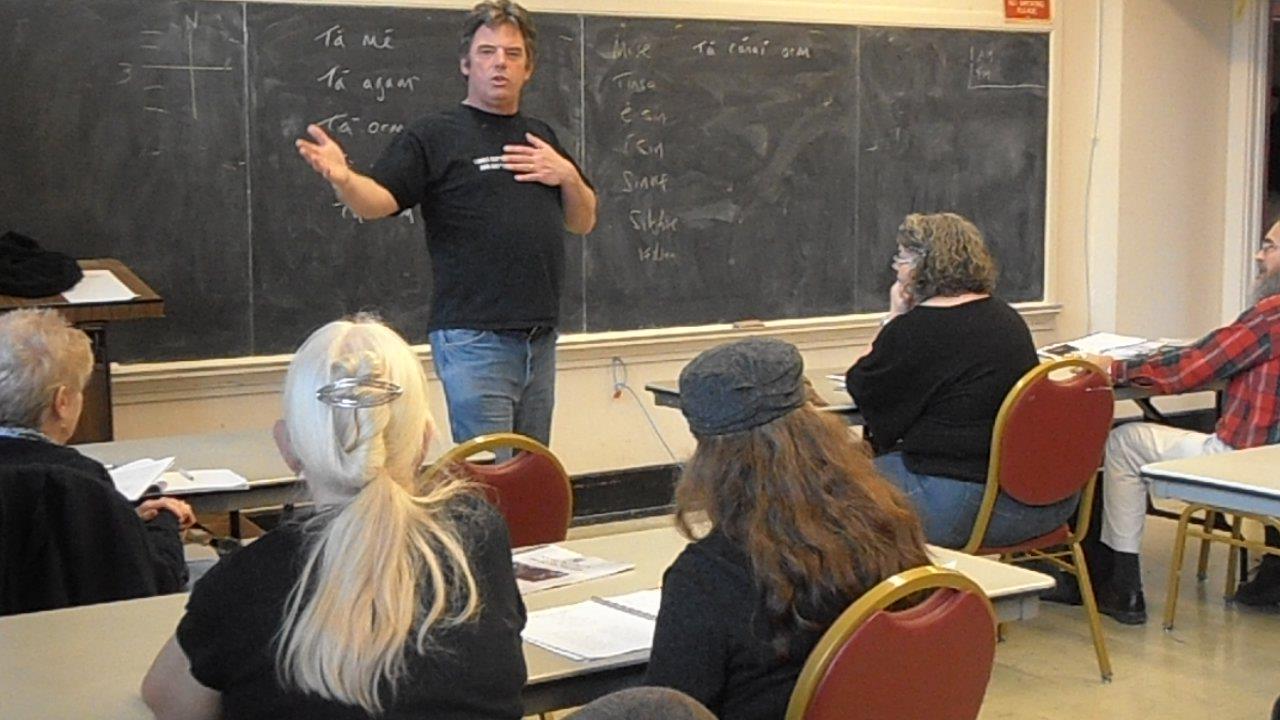 Traolach O'Riordain teaches a language class (unknown photo credit)
