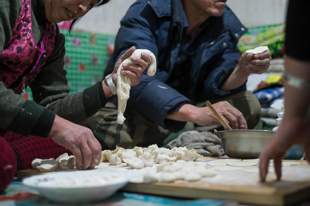 Preparing dumplings for New Year's day