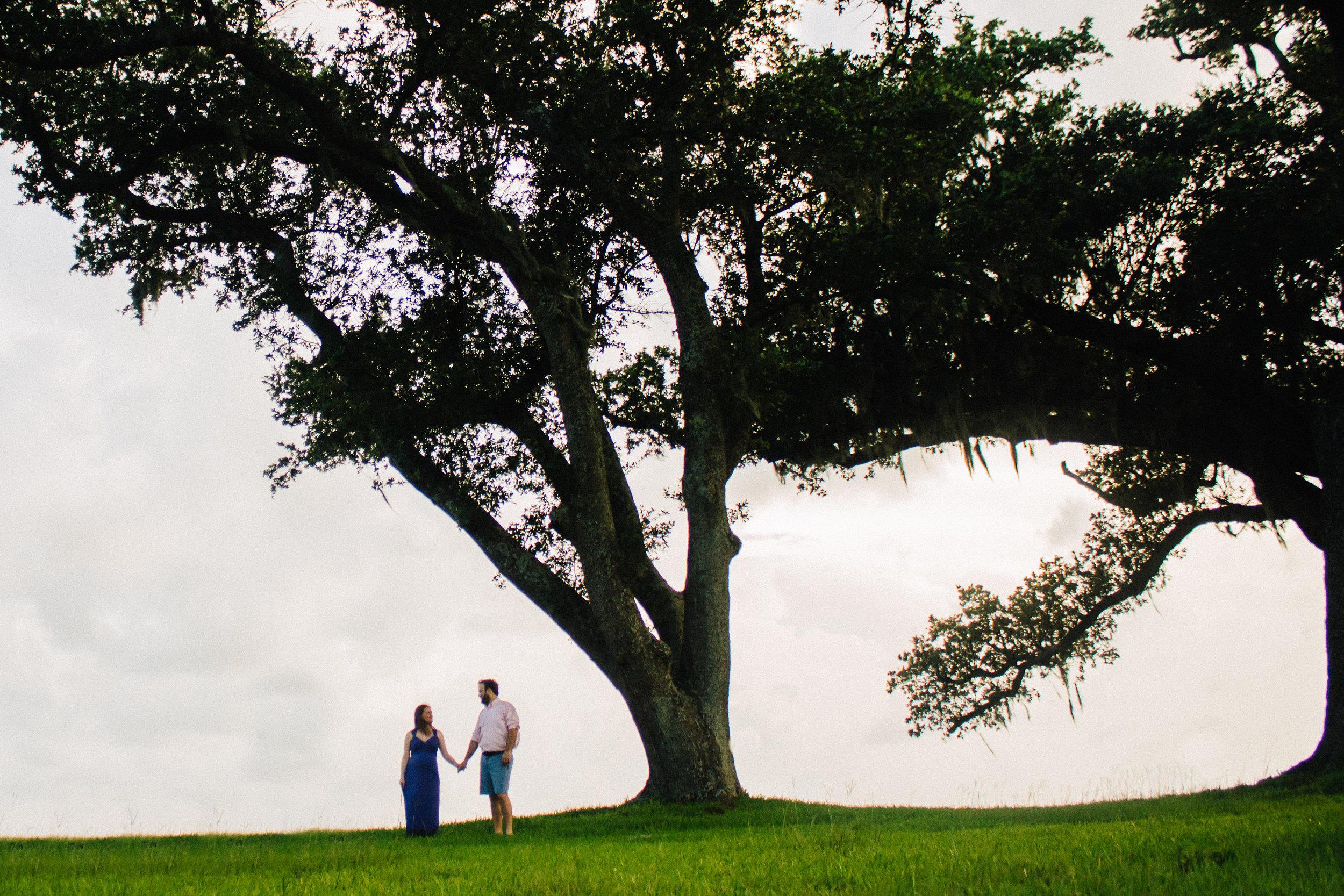 wide angle couple photo with live oak tree