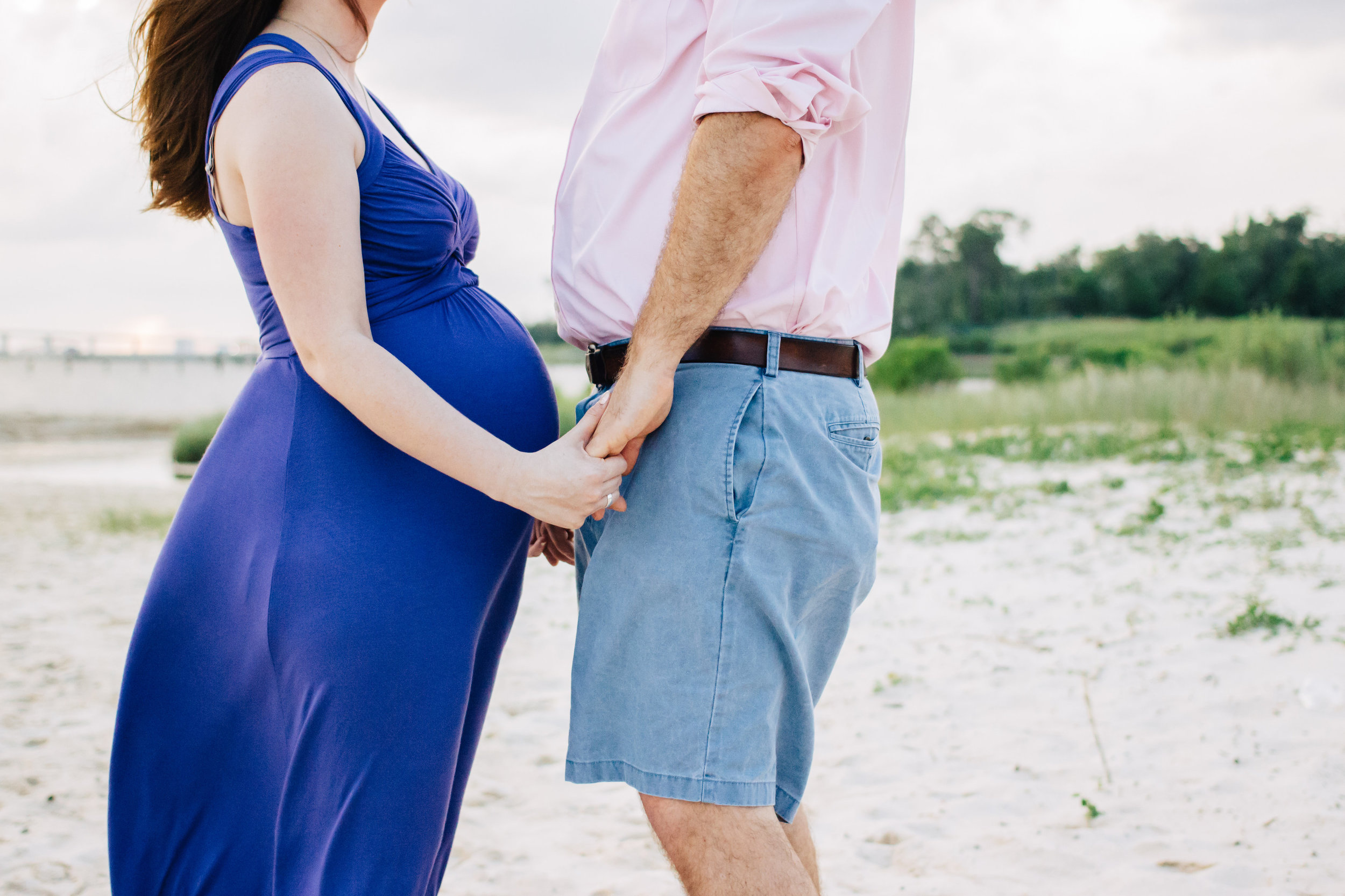 faceless maternity photo on beach