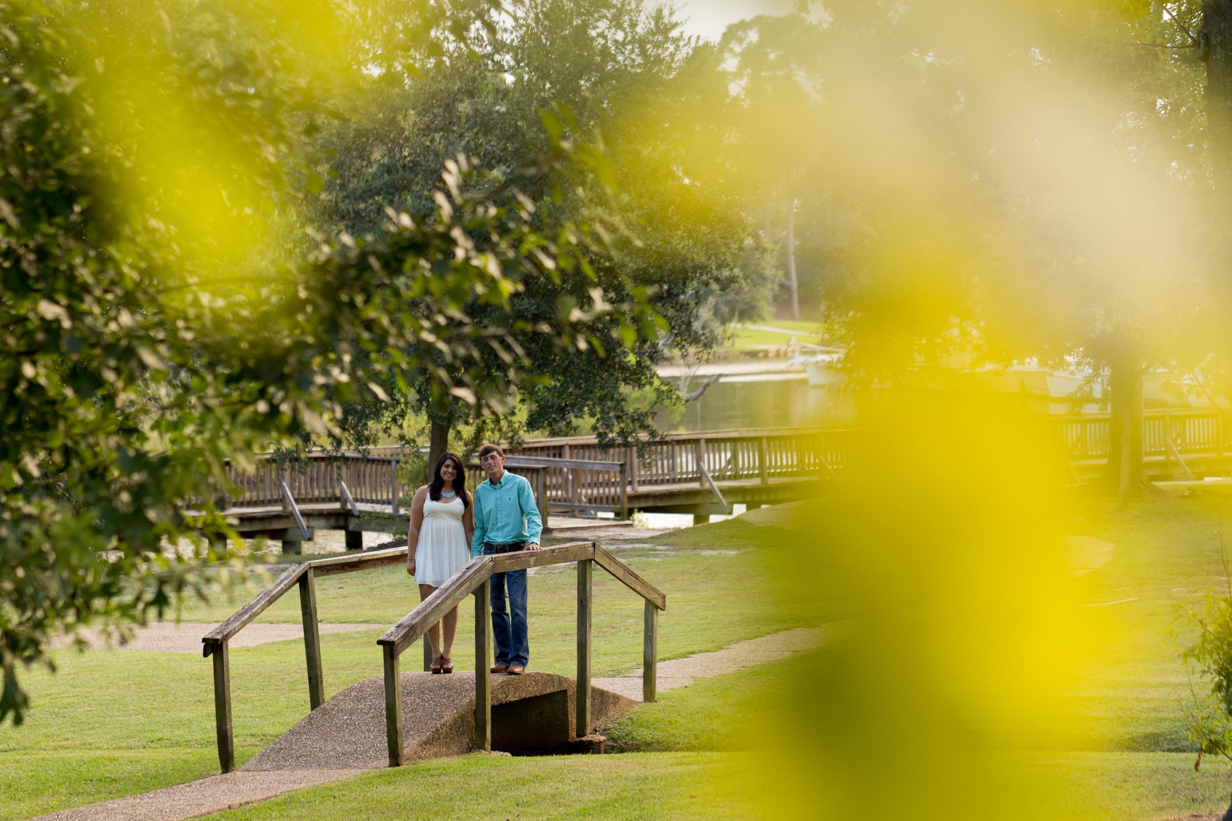engagement photo on wooden bridge in Ocean Springs, Mississippi