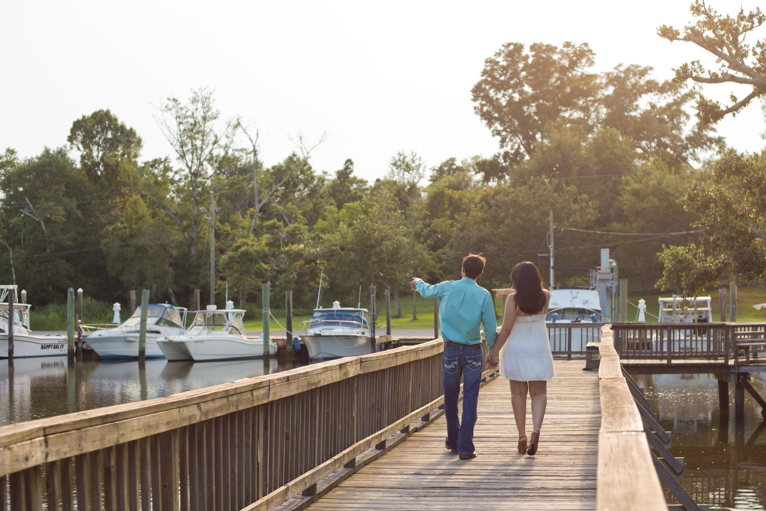couple walking on boat dock, Inner Harbor Park, Ocean Springs
