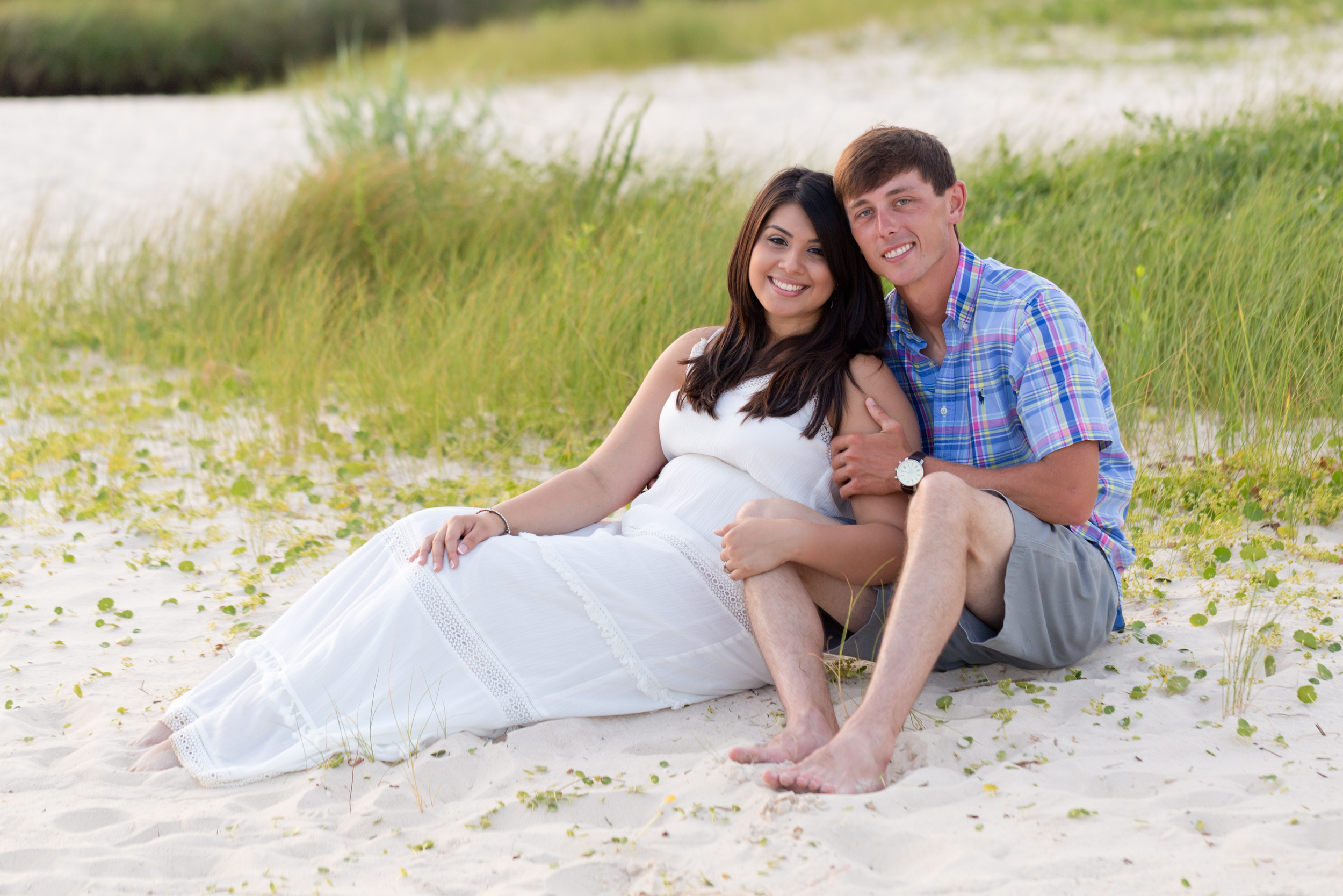 engagement portrait on East Beach, Ocean Springs (couple sitting in sand)