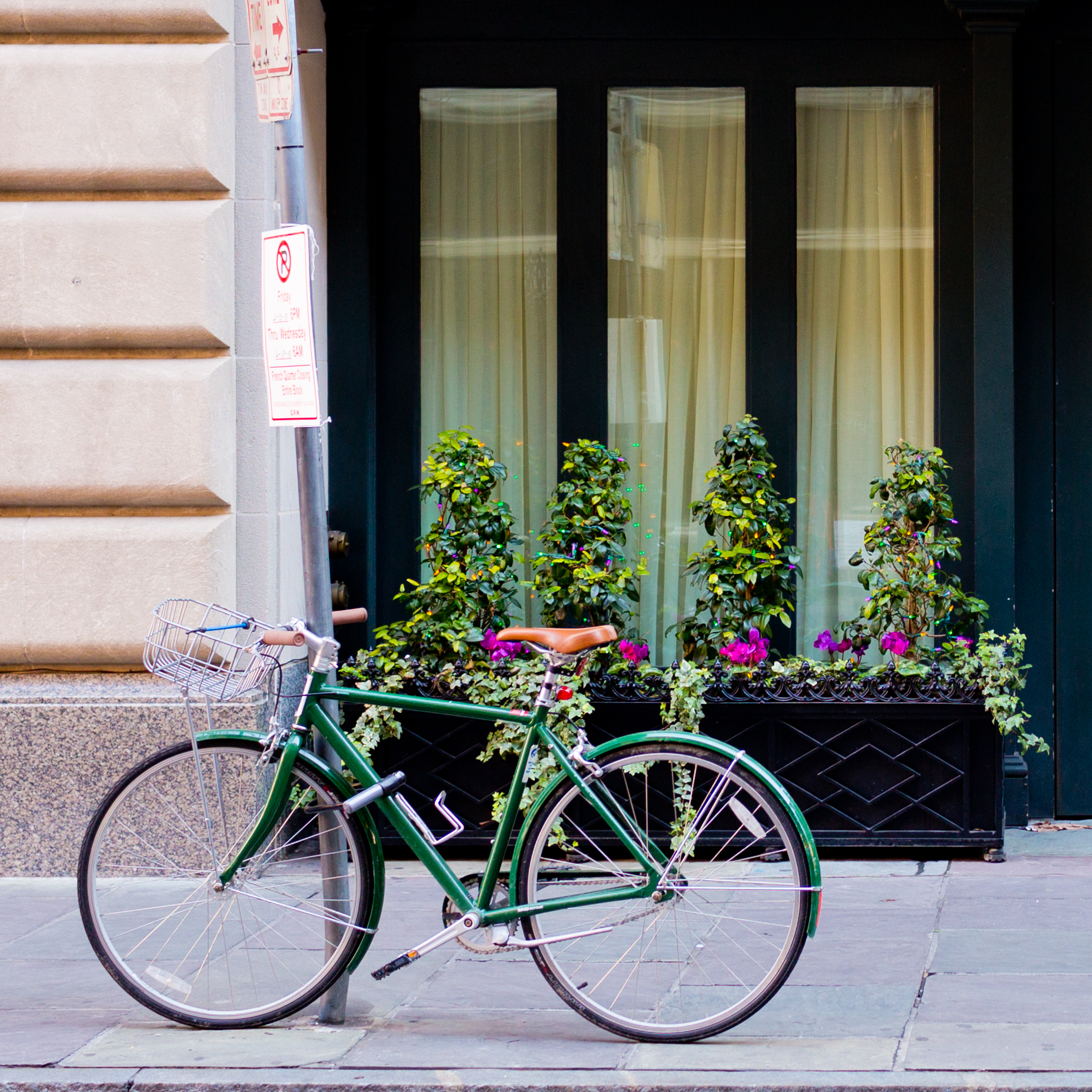 bicycle and flower window boxes on New Orleans sidewalk