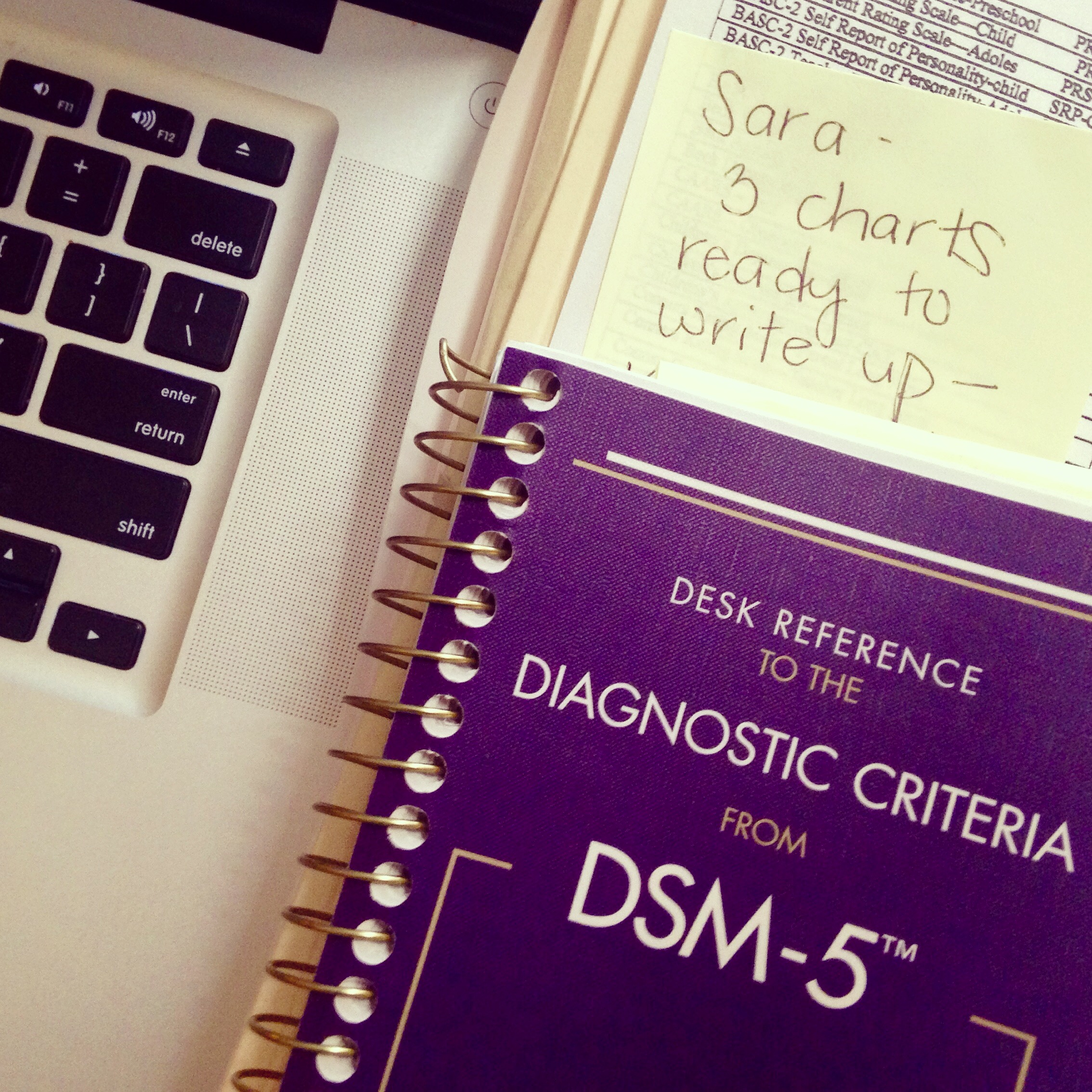 DSM-5, computer keyboard, post-it note, psychology work