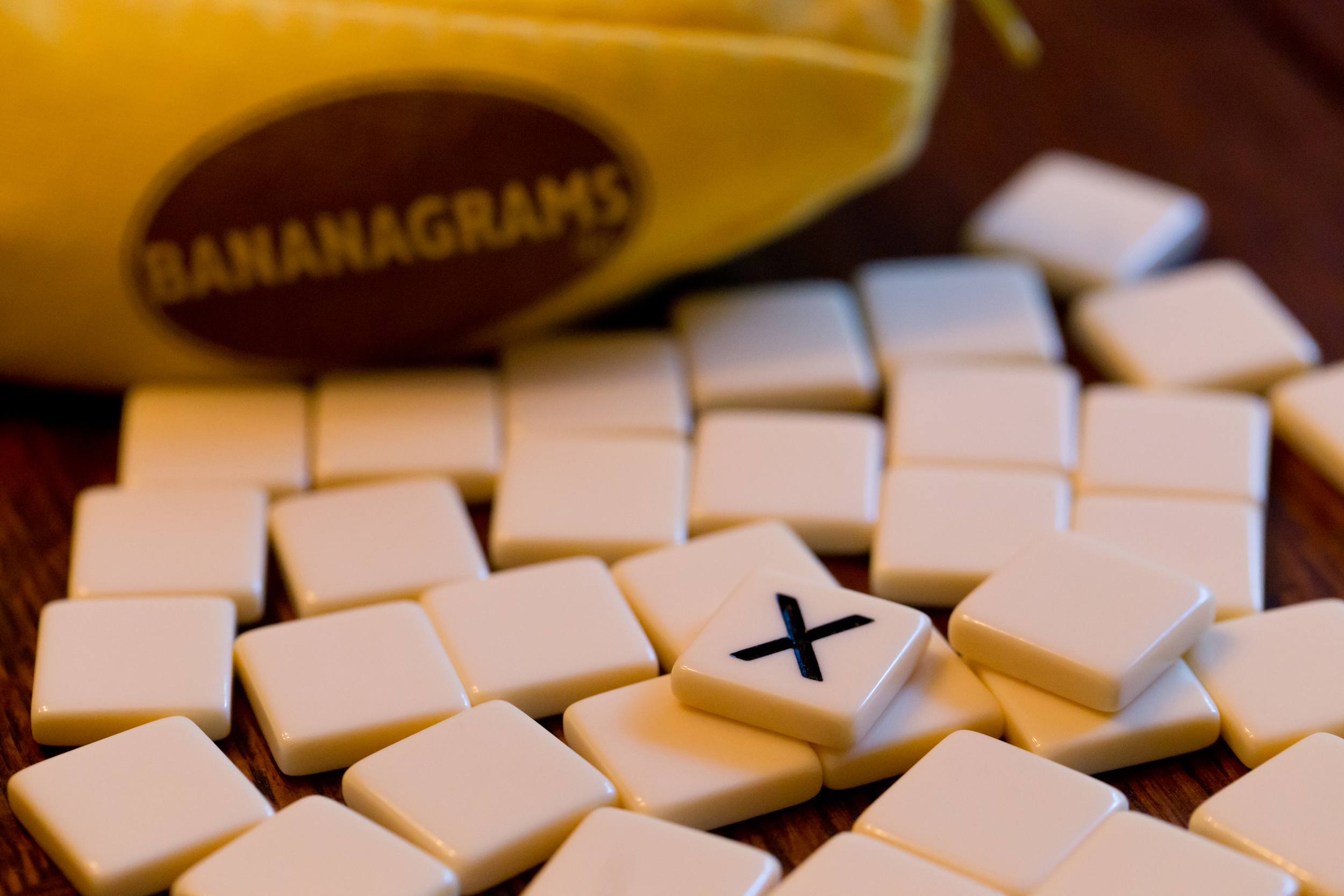 Banangrams game tiles, letter X