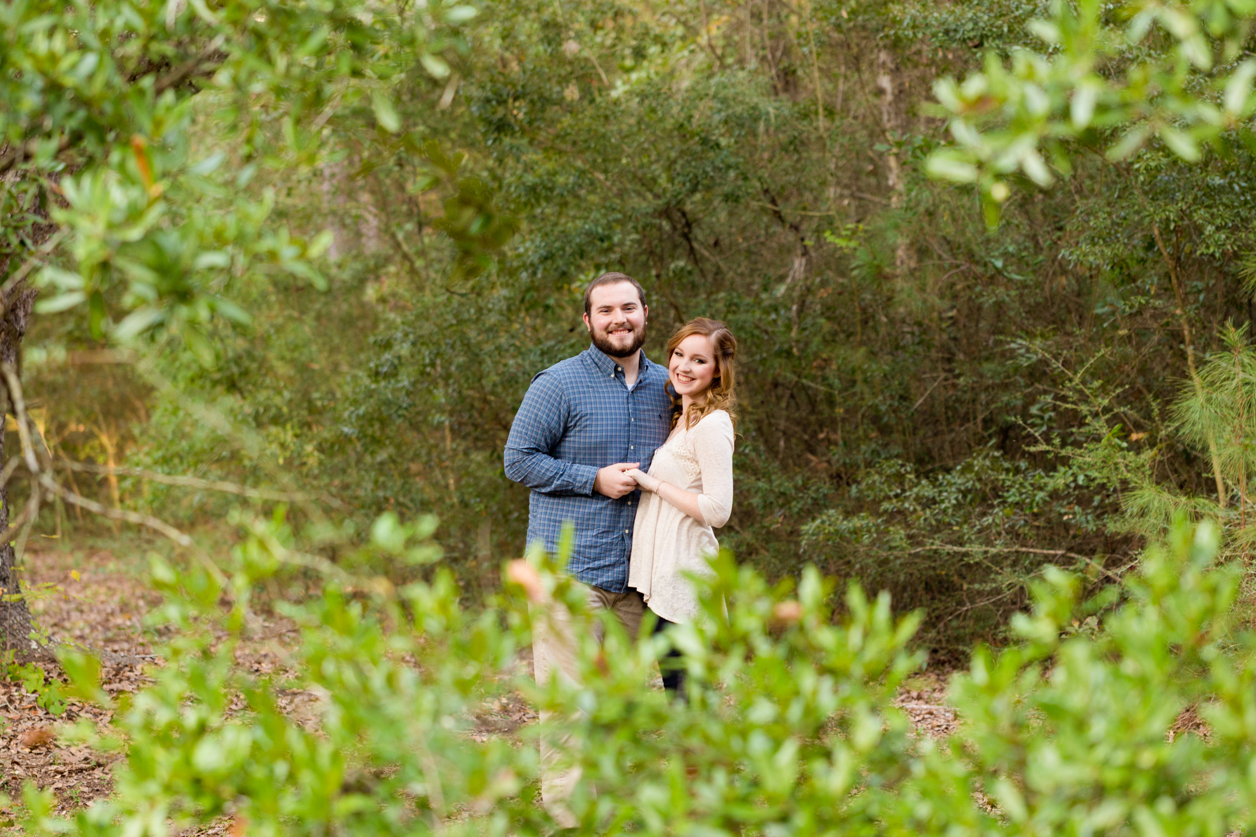 outdoor engagement photo with green leaves (Ocean Springs Engagement Photographer)