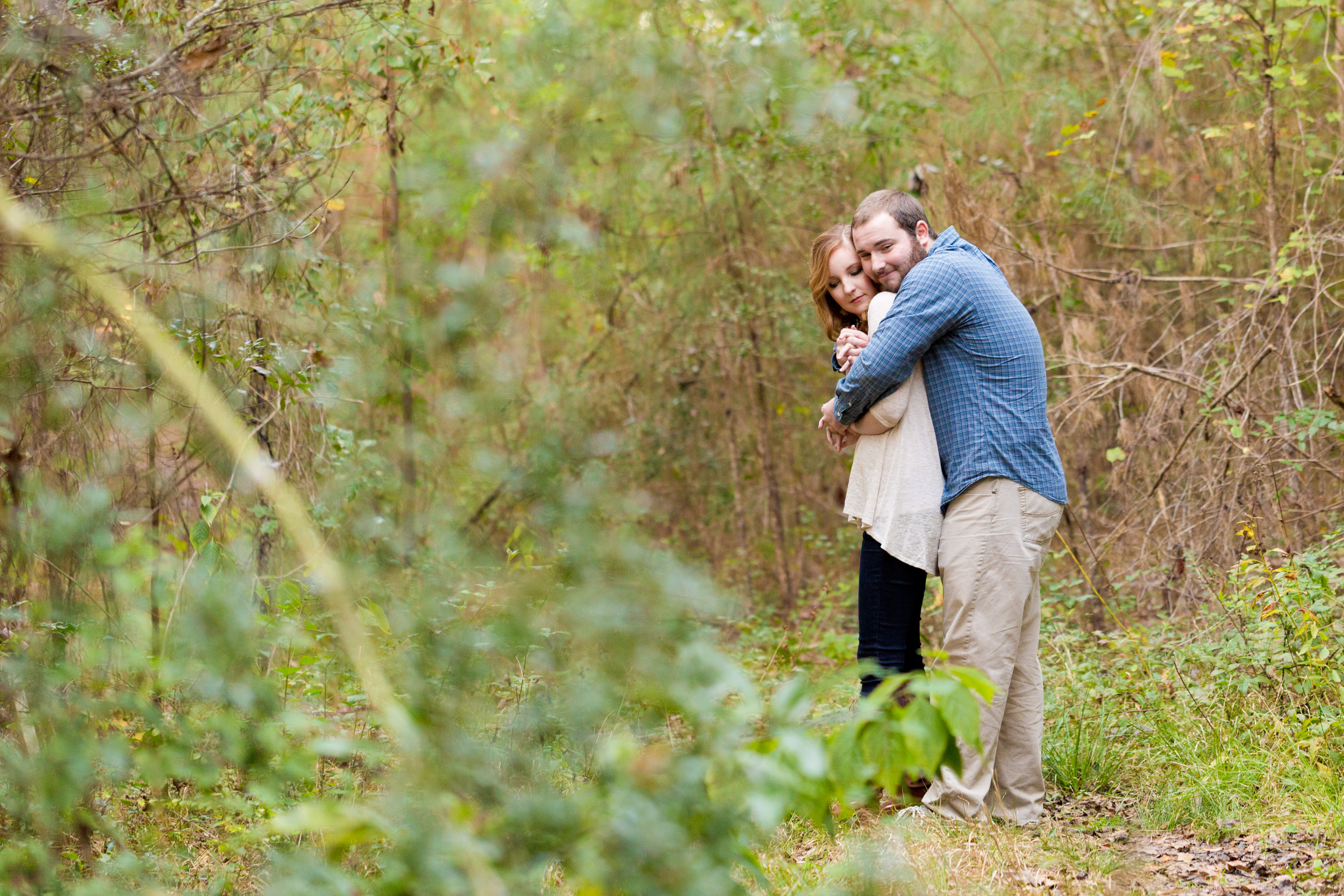 couple in woods (Ocean Springs engagement photographer)