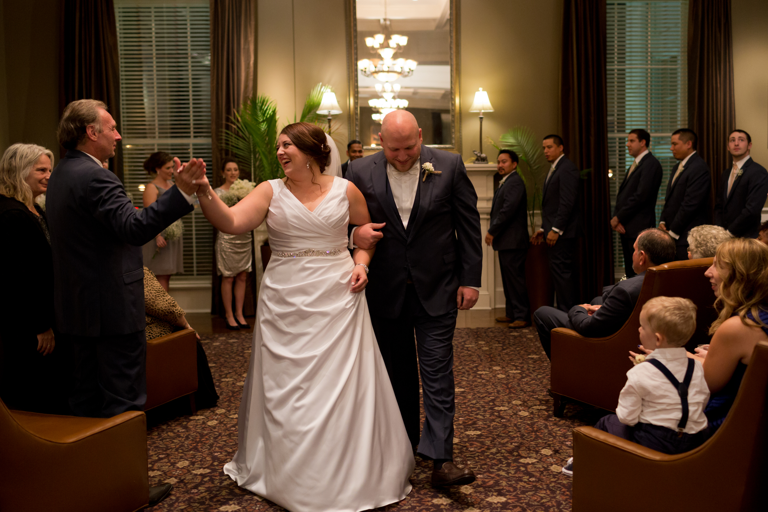 bride and father of the bride high five at end of wedding ceremony
