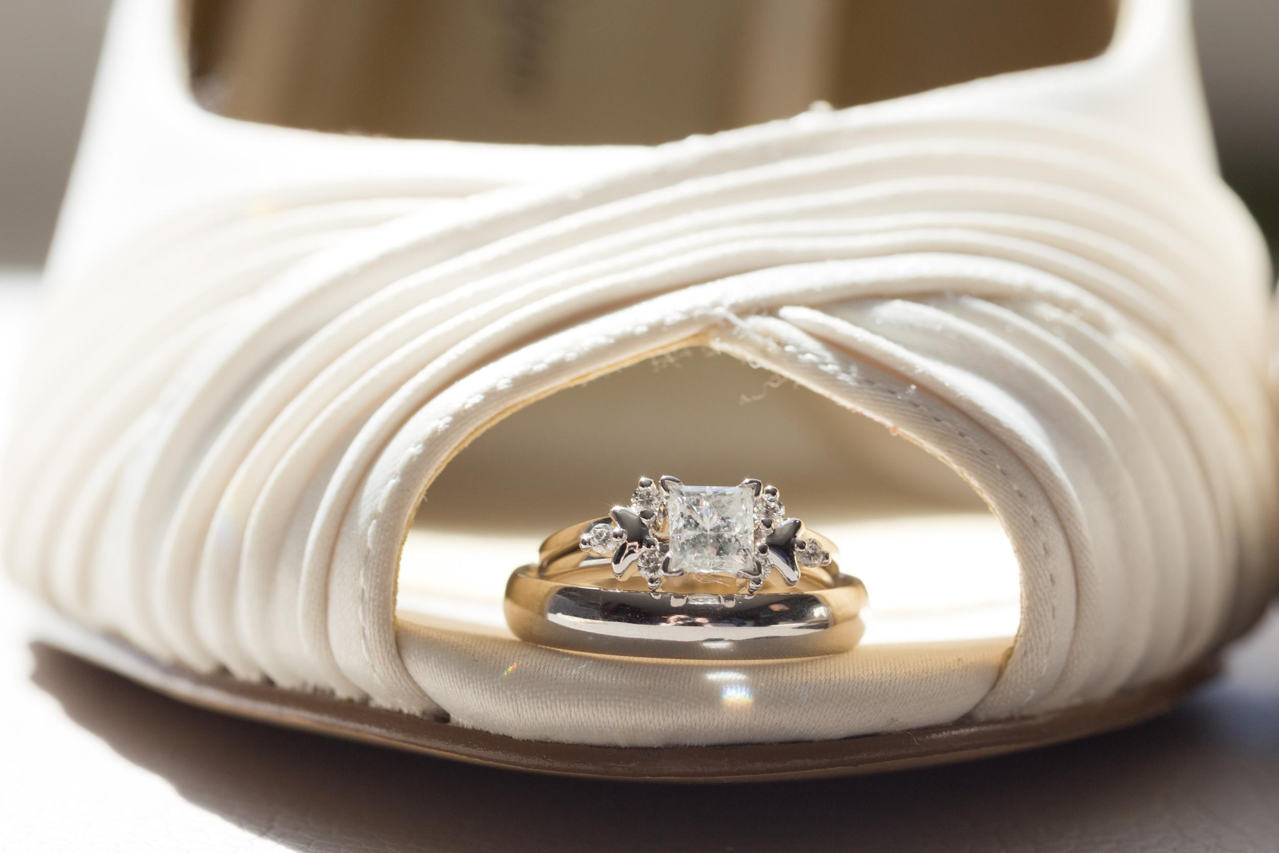 wedding rings on peep-toe bridal shoes