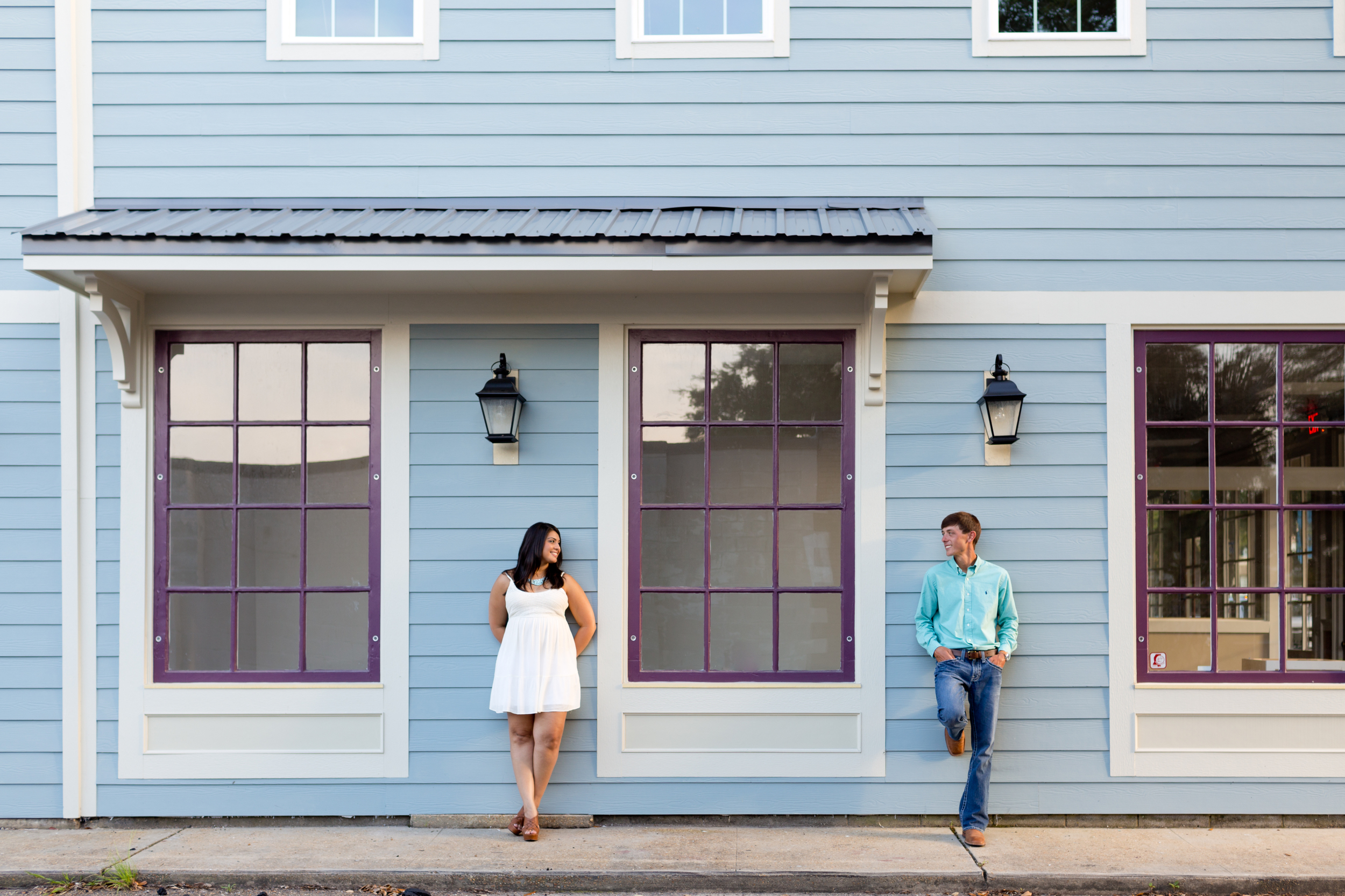engagement photo in downtown Ocean Springs (Uninvented Colors Photography)