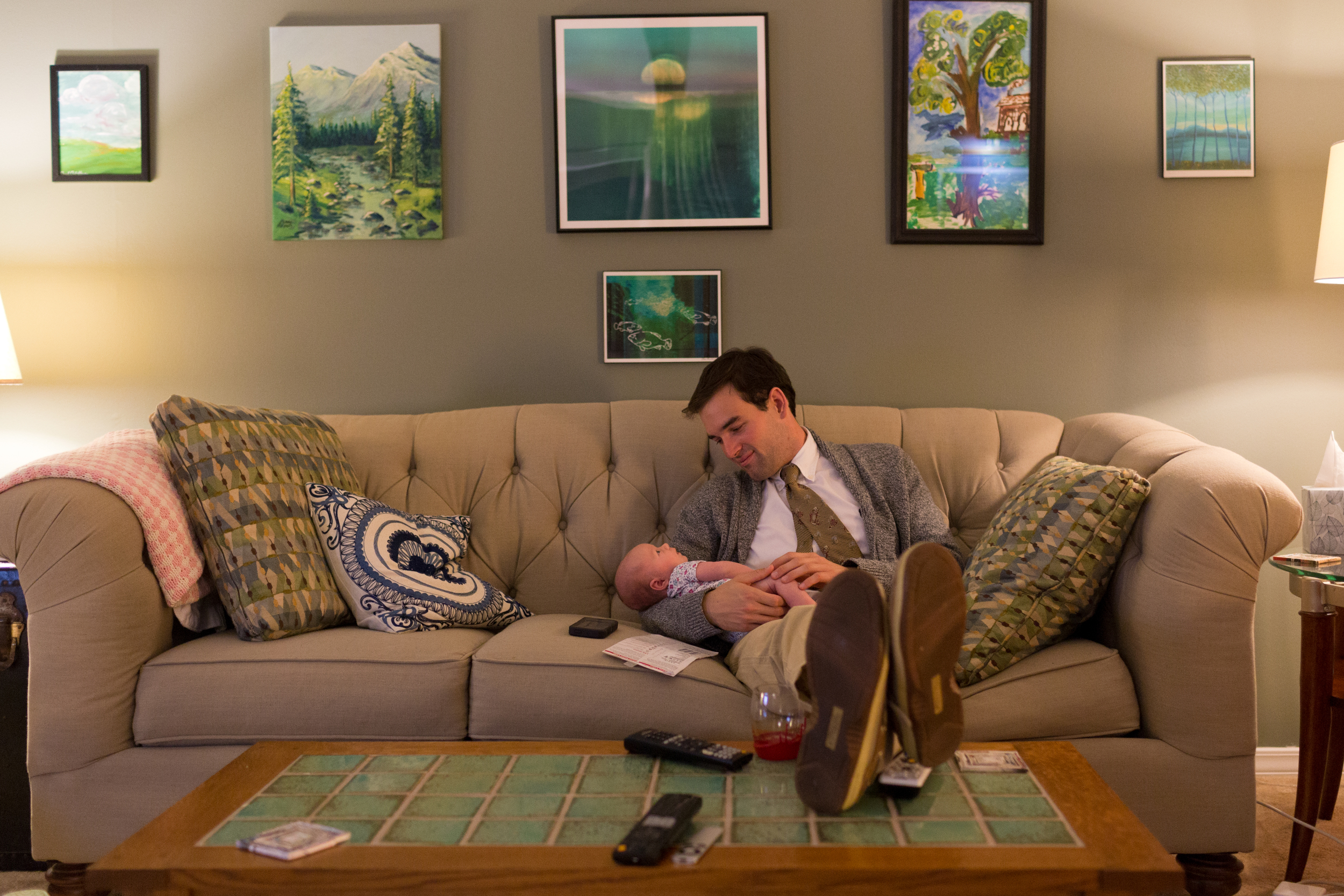 uncle sitting on couch with baby niece