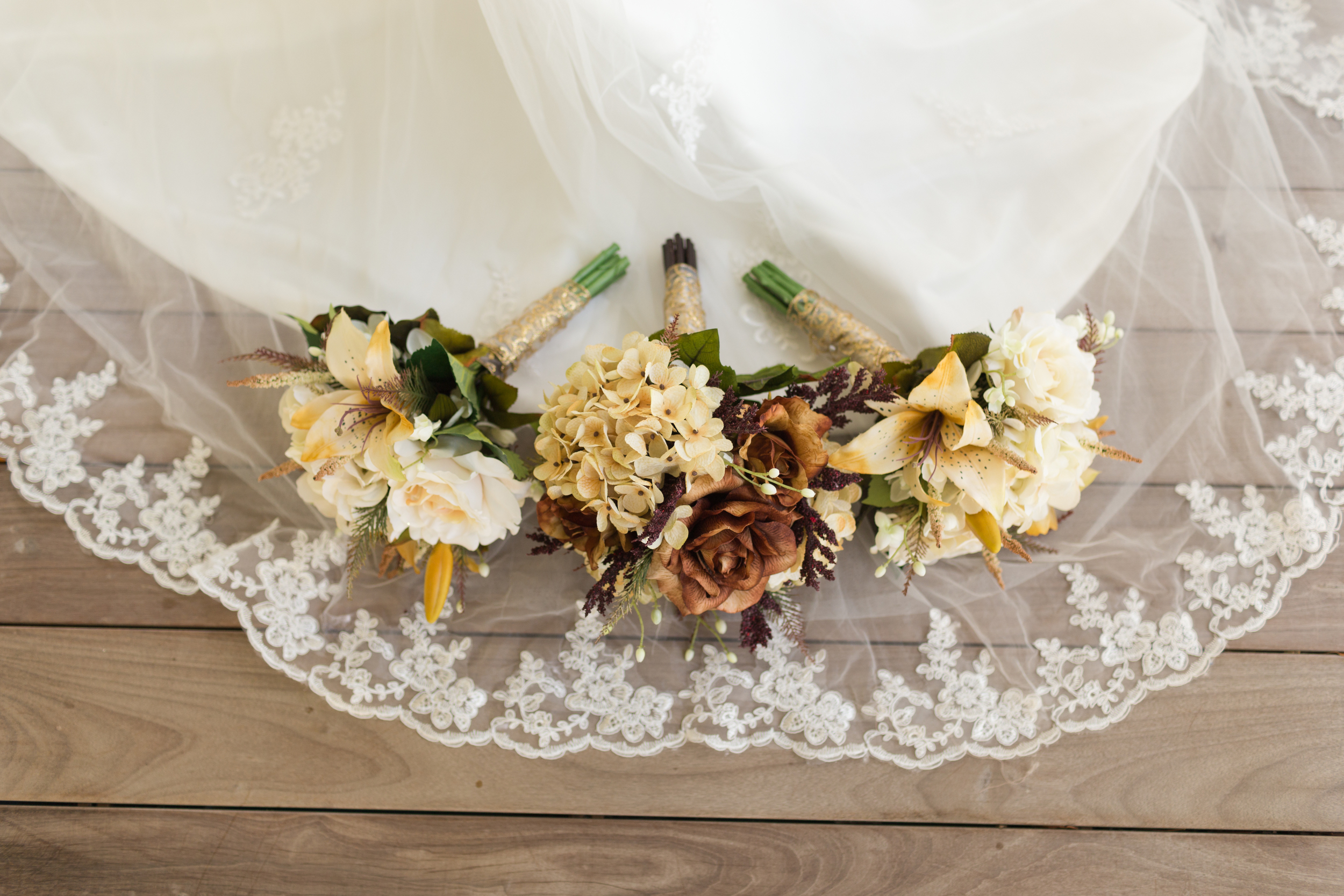 bridesmaids bouquets on lace veil