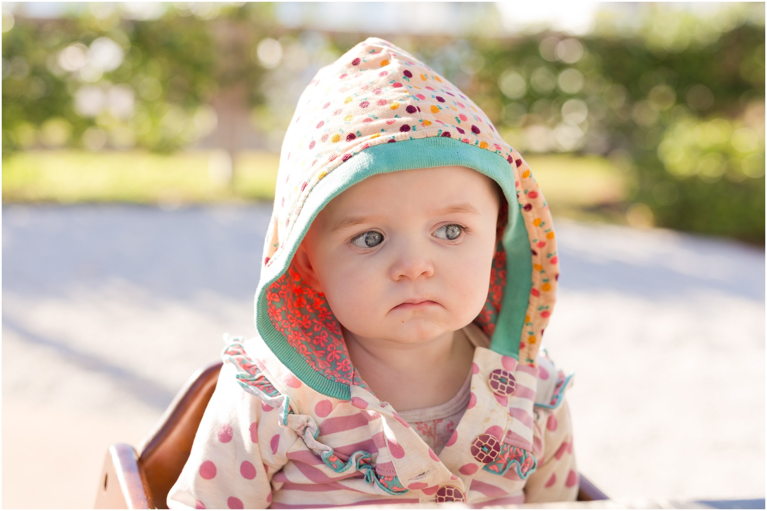 baby girl with funny skeptical facial expression